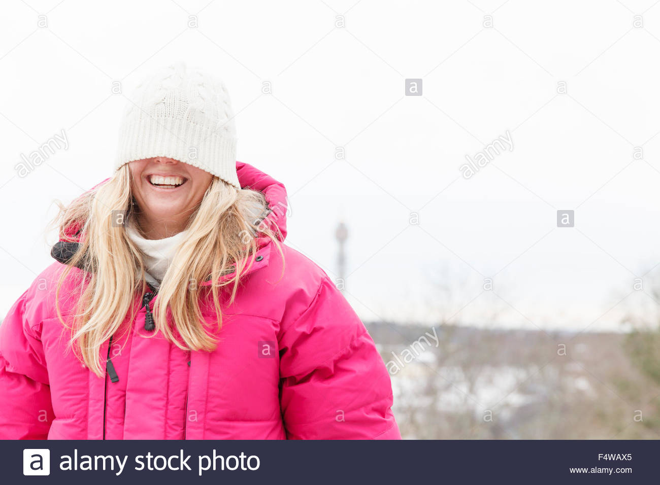 Sweden, Stockholm, Ostermalm, Young woman fooling around with knit hat - Stock Image