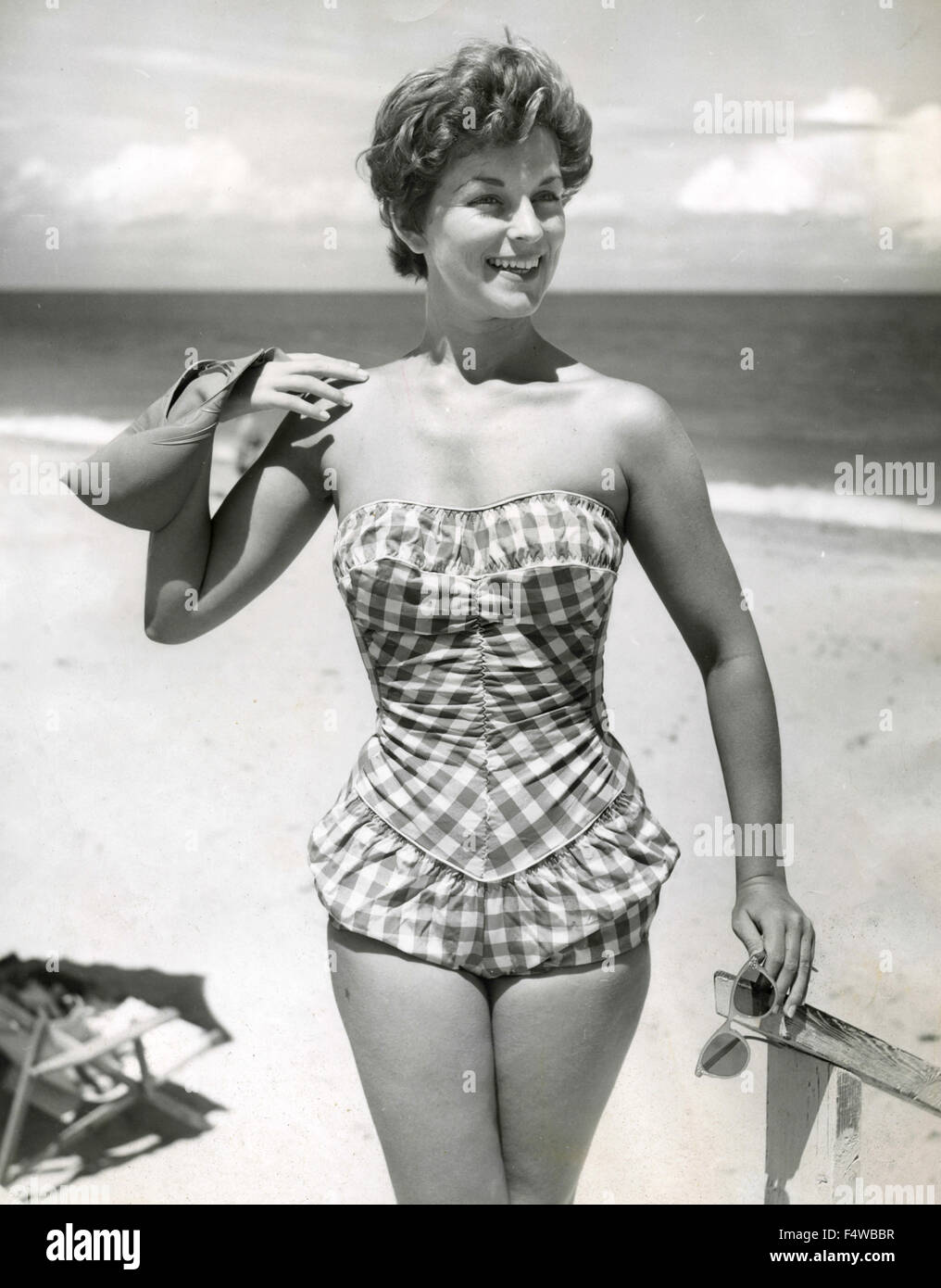 A model presents a swimsuit 50s - Stock Image