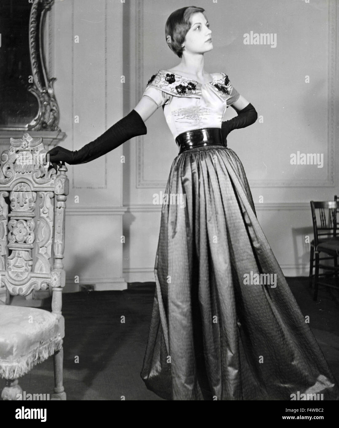 A model presents a dress by English designer Victor Stiebel - Stock Image