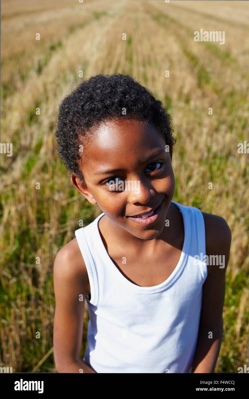 Sweden, Vastra Gotaland, Gullspang, Runnas, Portrait of smiling boy (8-9) - Stock Image