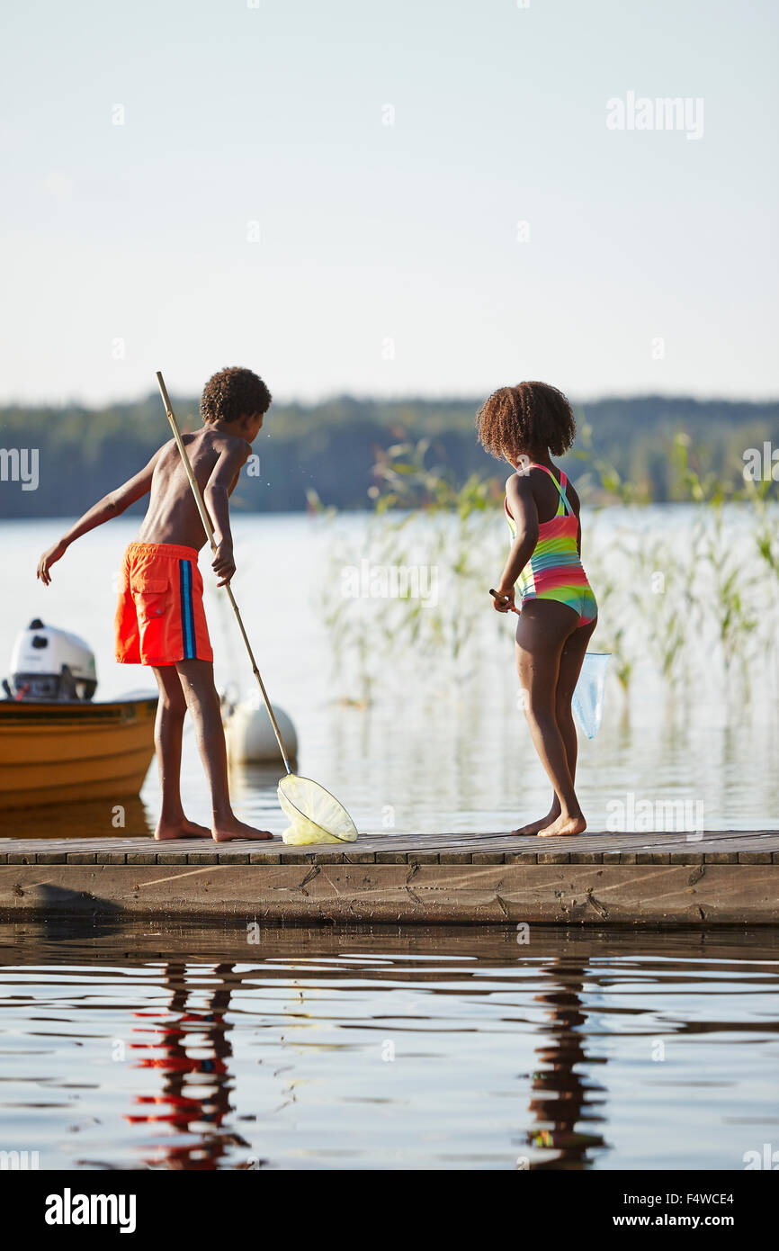 Sweden Vastra Gotaland Skagern Girl 6 7 And Boy 10 11 Fishing Stock Photo Alamy