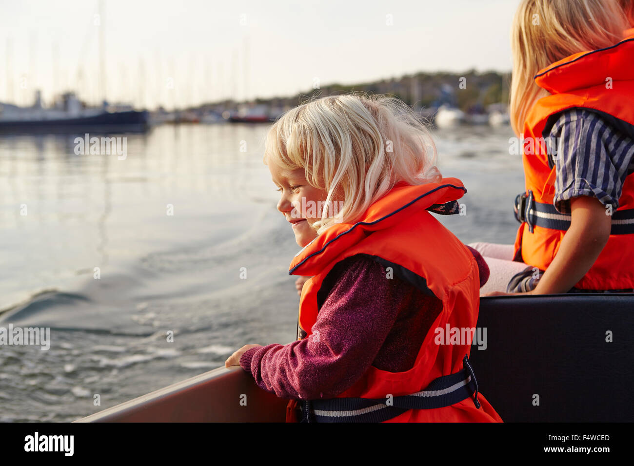 Sweden, Swedish West Coast, Vastra Gotaland, Two girls (4-5) on tour boat - Stock Image