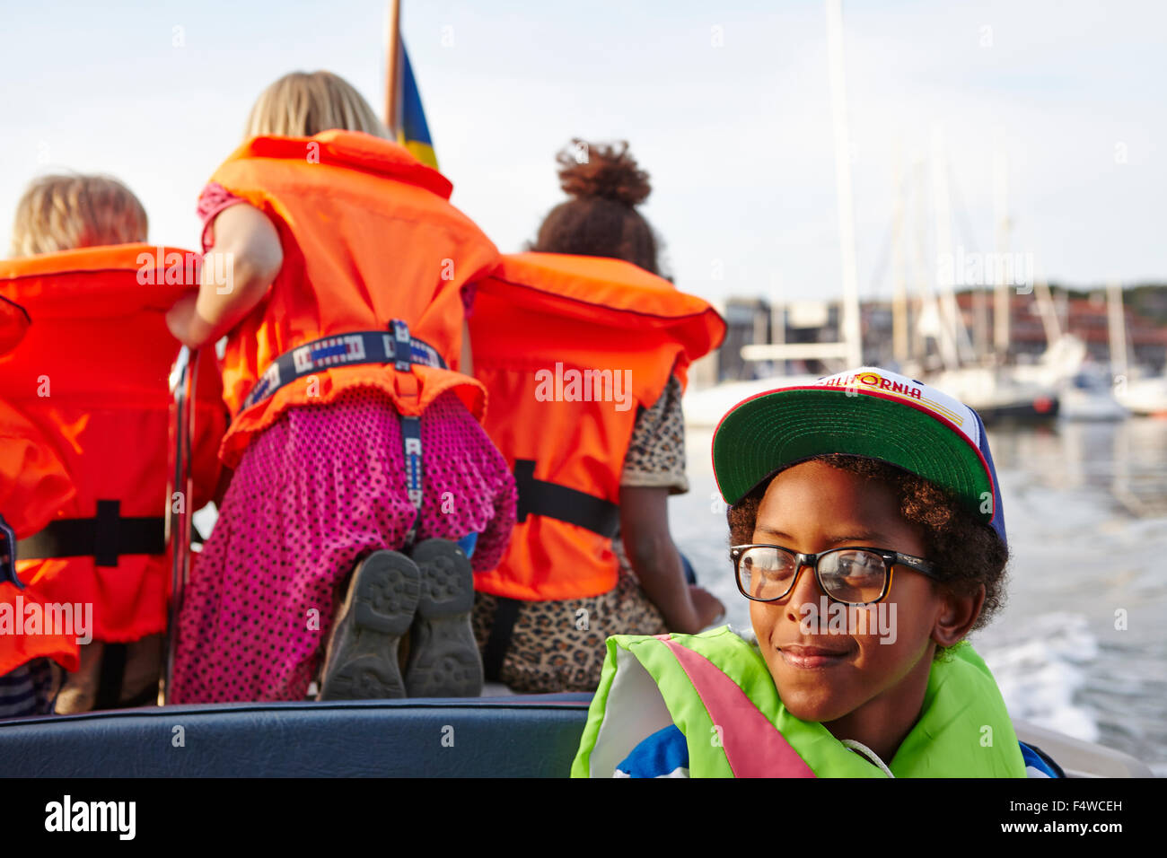 Children (6-7, 10-11) on tour boat - Stock Image