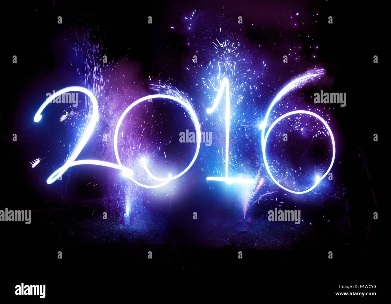2016 Fireworks party -  Happy New Year Display celebrations!2016 written in lights trails and fireworks. - Stock Image