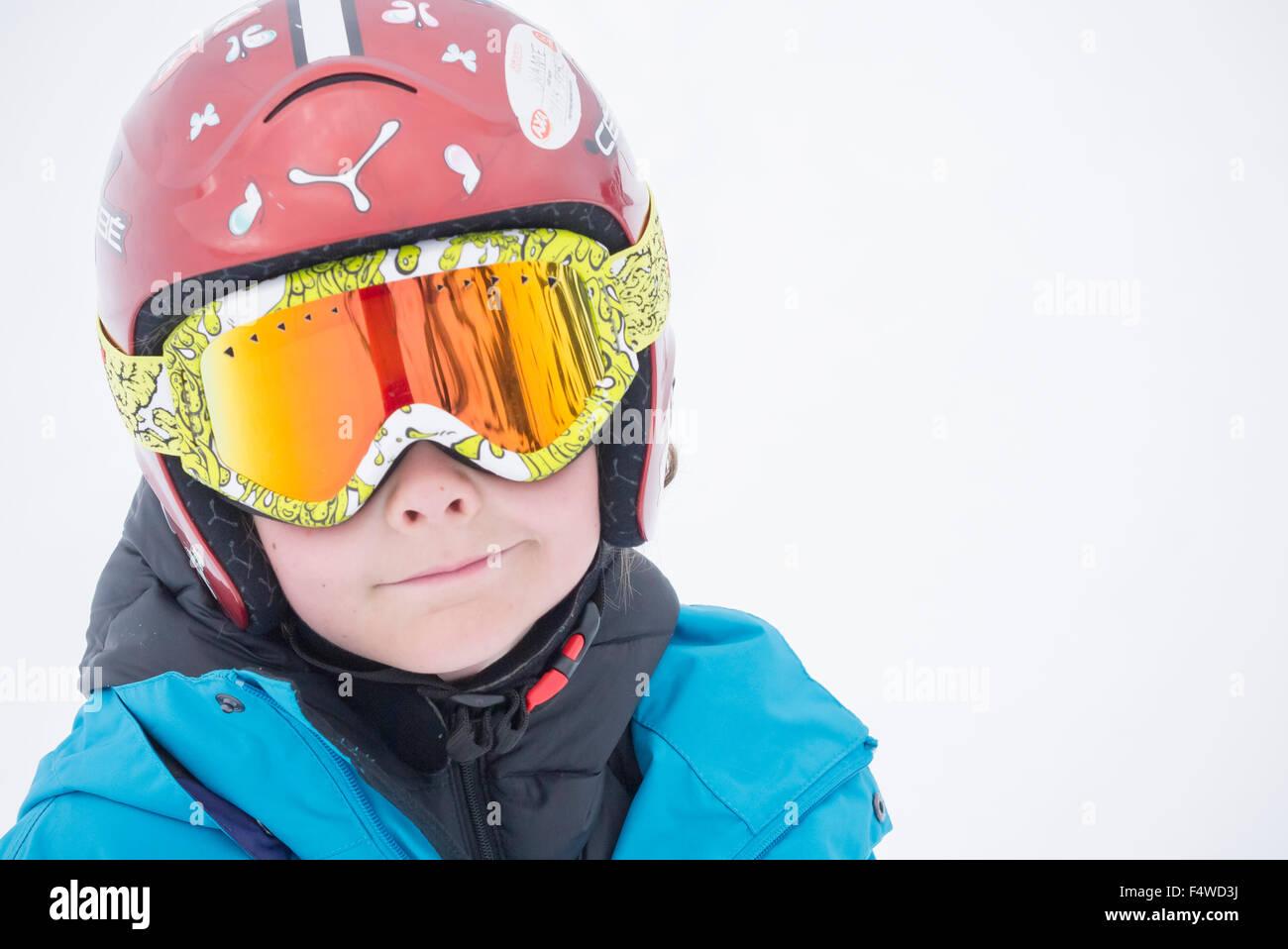 Portrait of boy (10-11) wearing helmet and ski goggles - Stock Image