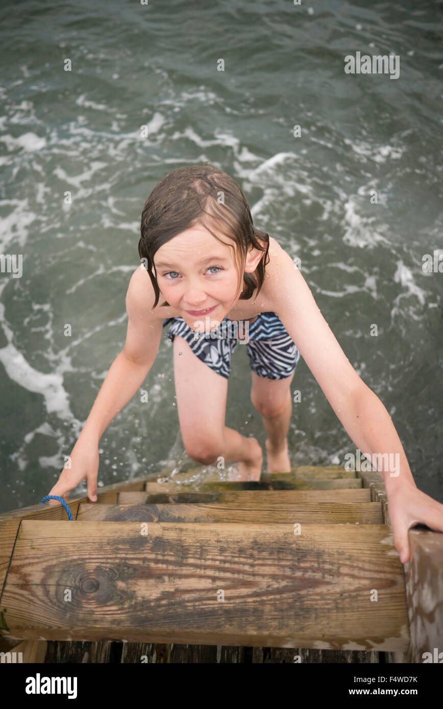 Sweden, Swedish West Coast, Halland, Onsala, Portrait of boy (10-11) swimming in sea - Stock Image