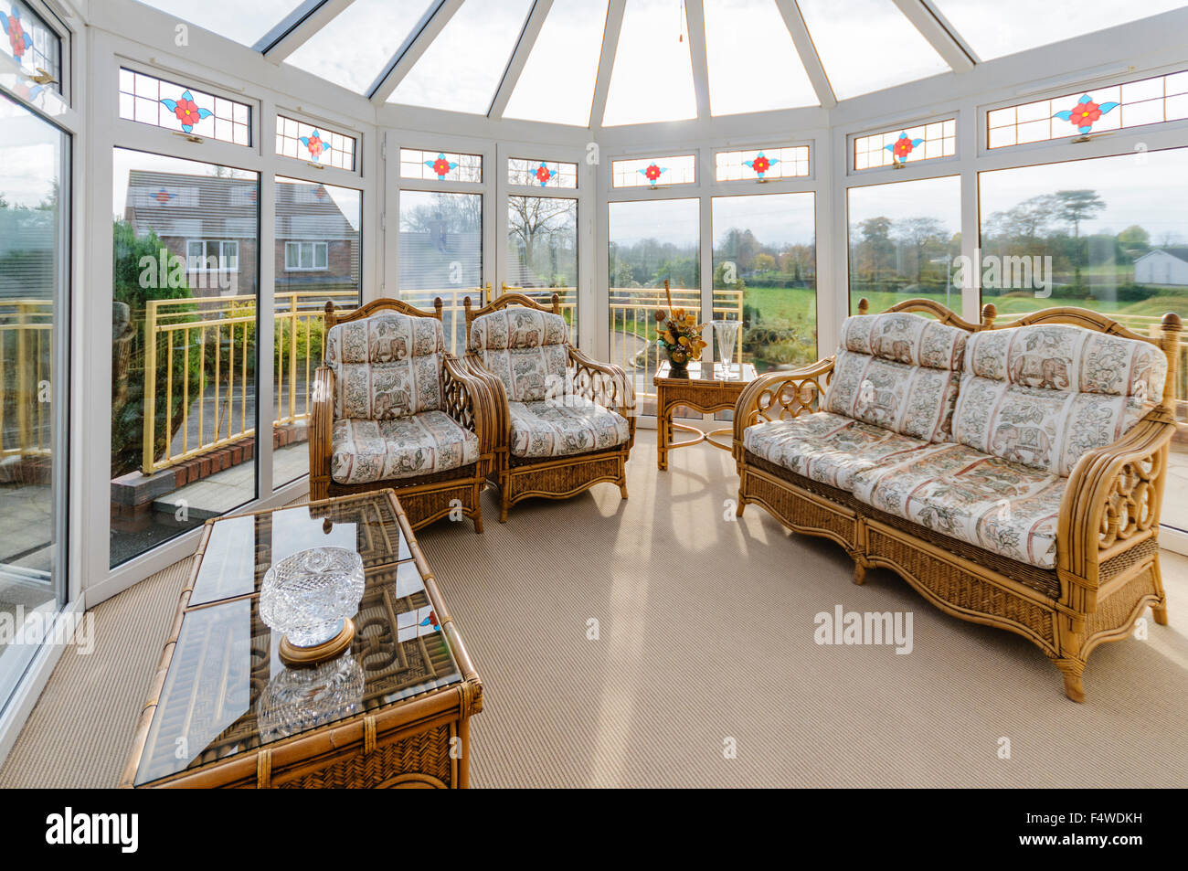 Household Conservatory With Cane Furniture   Stock Image