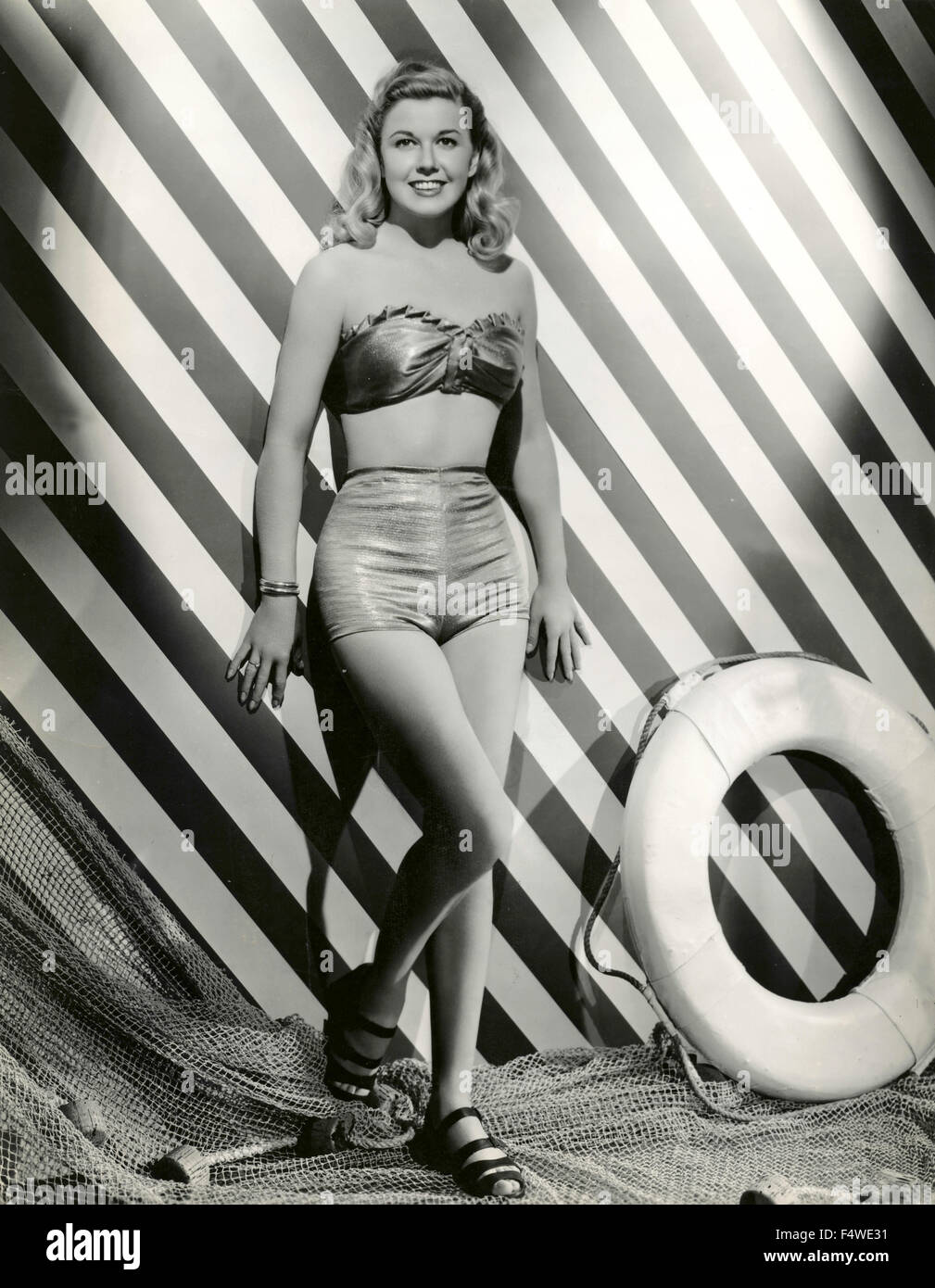 A model wears a swimsuit two-piece 40s - Stock Image