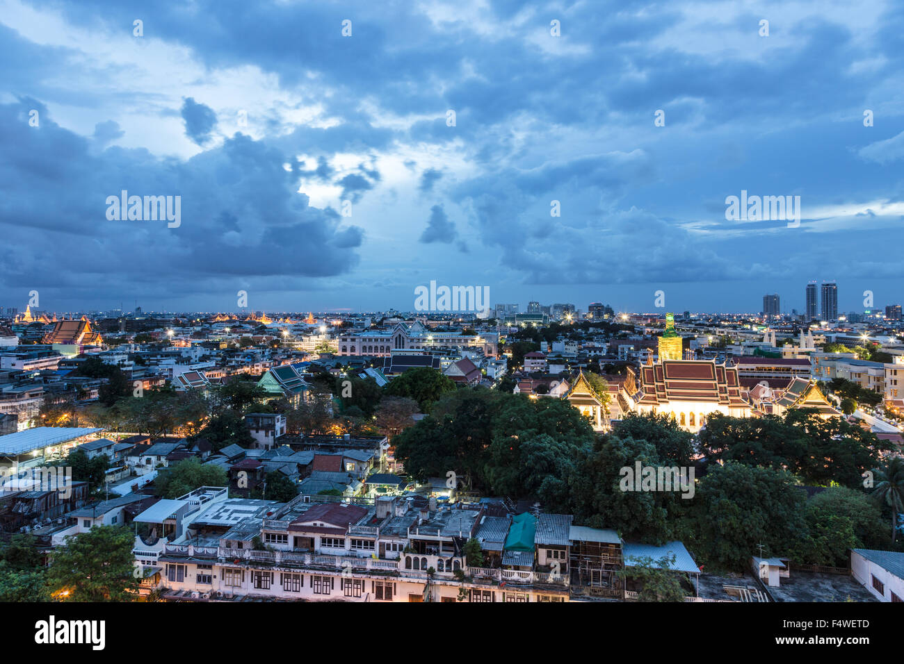 A view of Bangkok old city with lots of Buddhist temple (wat) at blue hour. Bangkok is thailand capital city - Stock Image