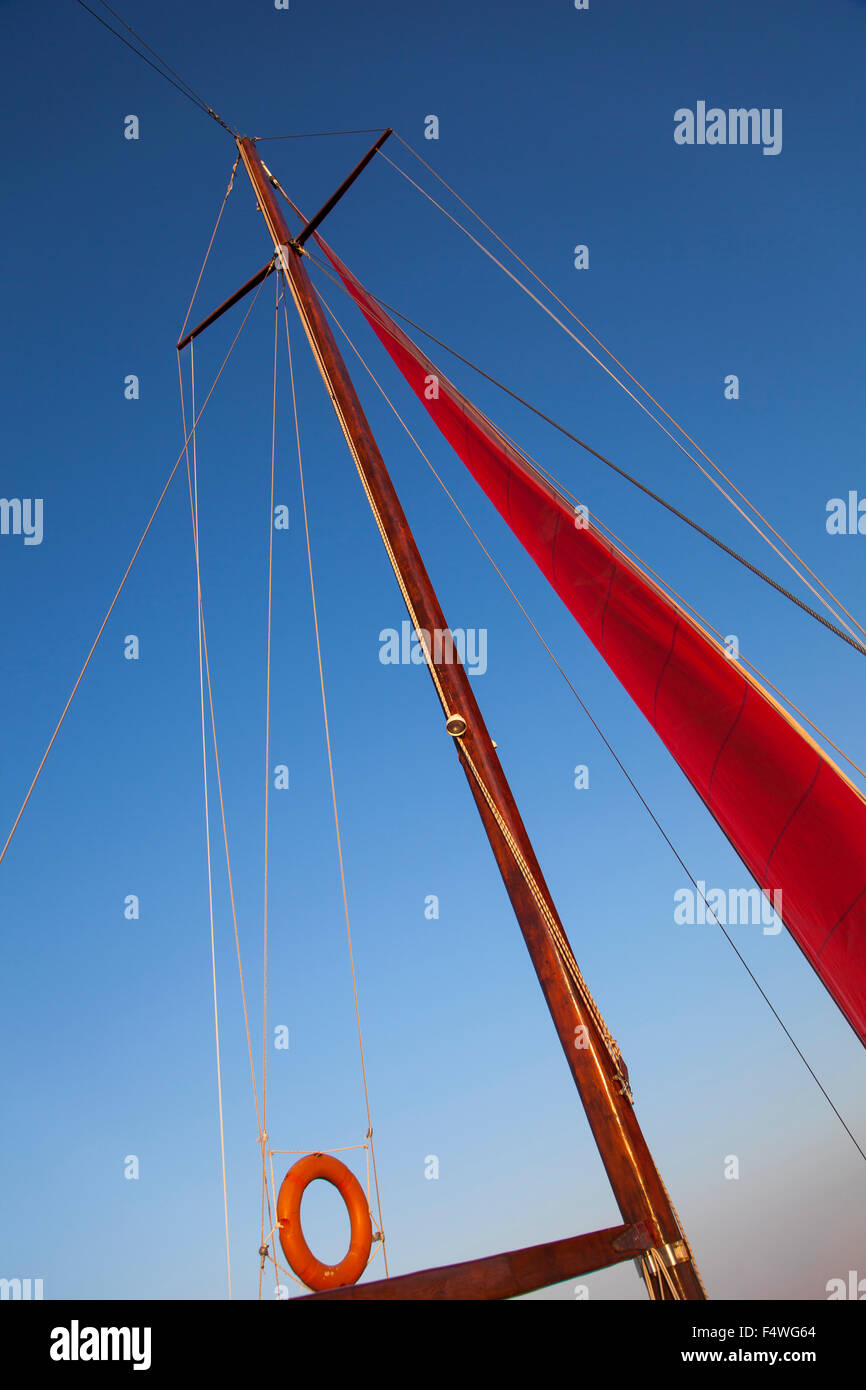 Image of a yacht mast and rigging during sailing in the sea. - Stock Image
