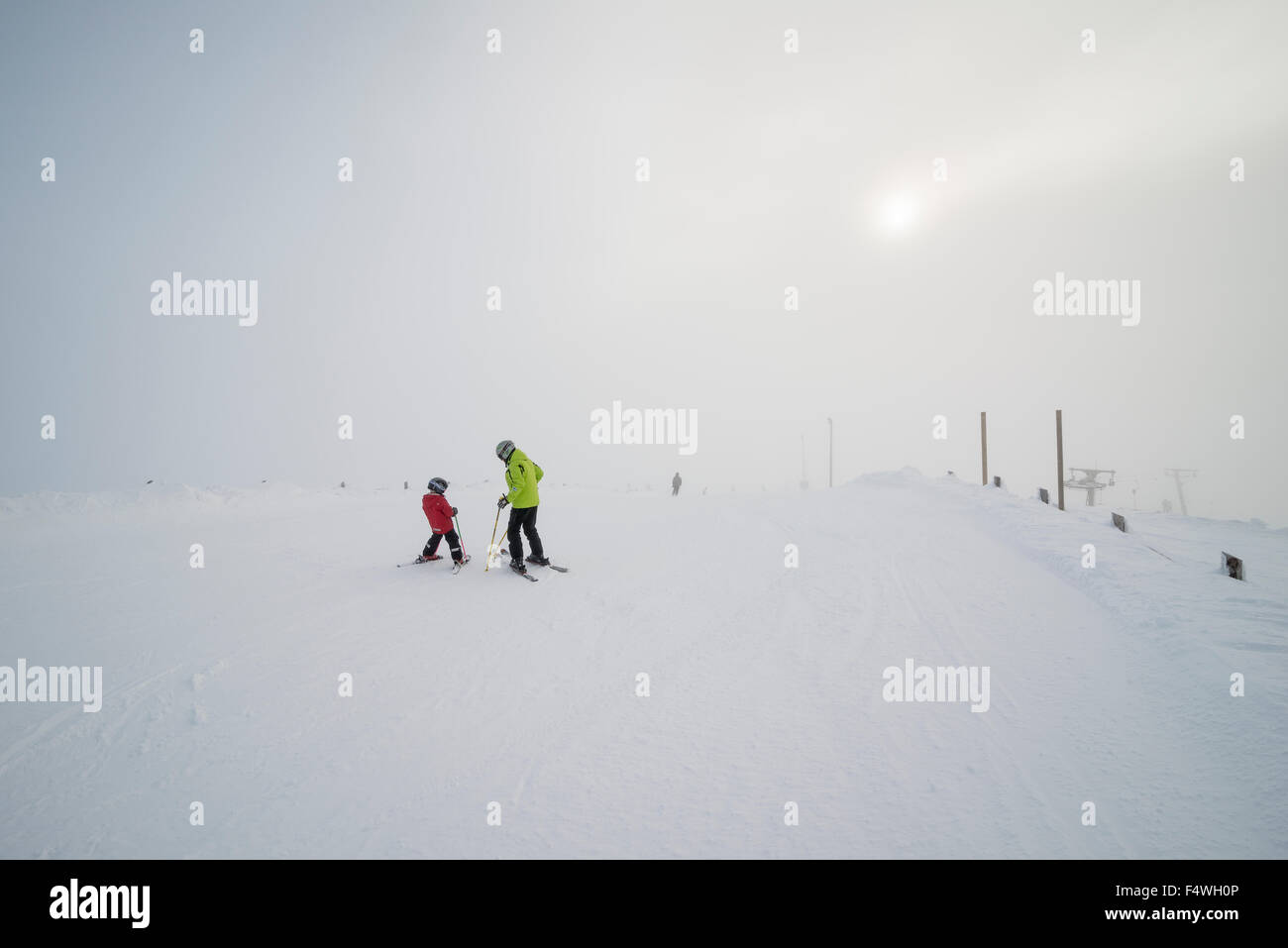 Finland, Lapland, Levi, Grandfather and grandson (6-7) skiing - Stock Image