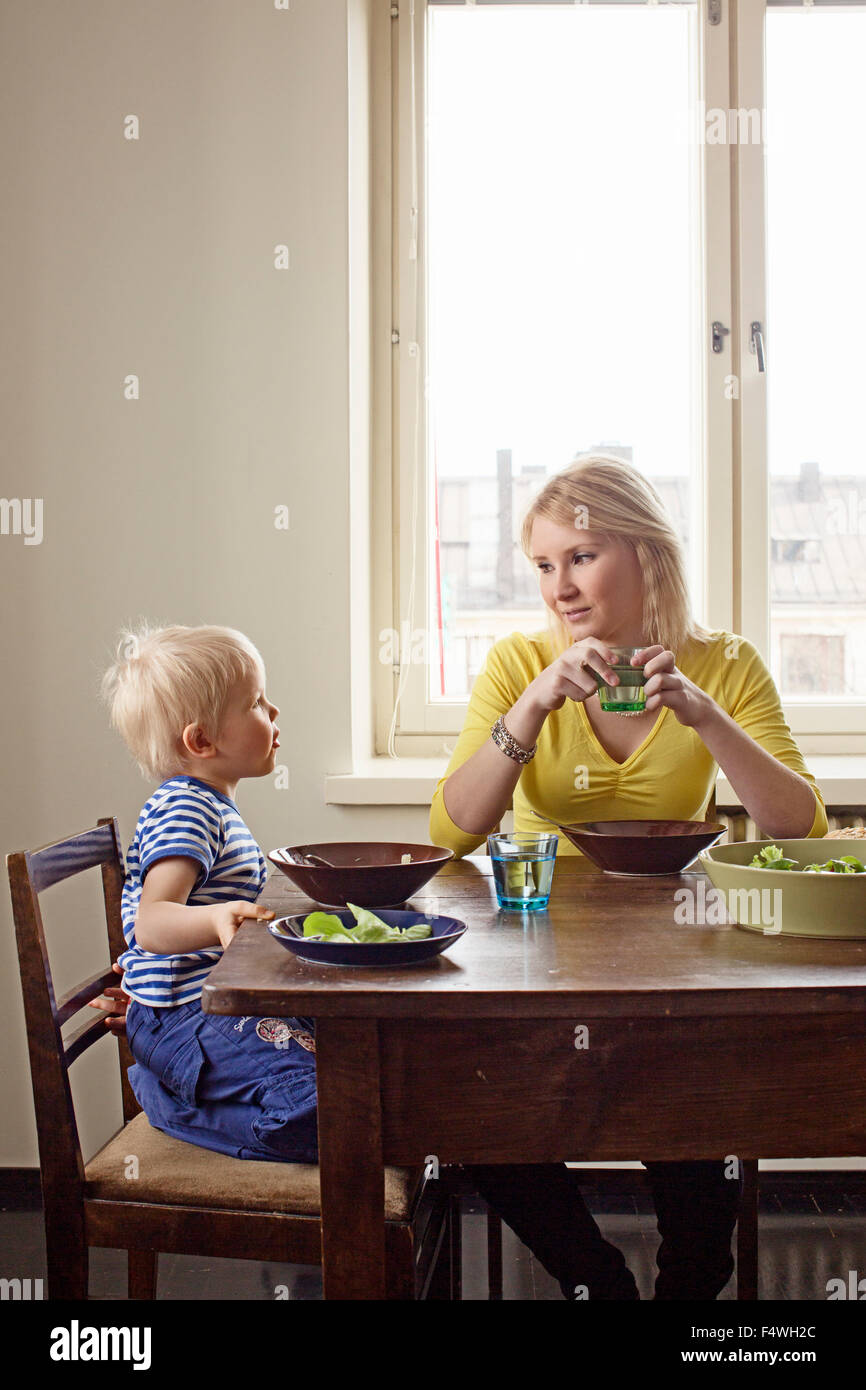 Finland, Helsinki, Kallio, Mother and son at lunch table - Stock Image