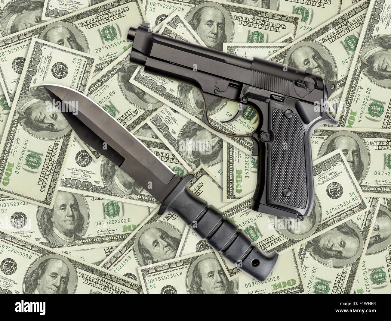 Knife and pistol placed on pile of american one hundred dollar bills - Stock Image