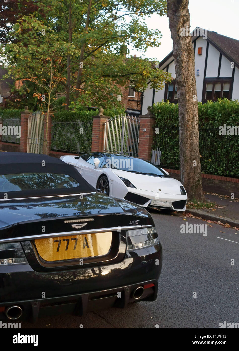 Luxury cars parked in street in wealthy North London neighbourhood - Stock Image