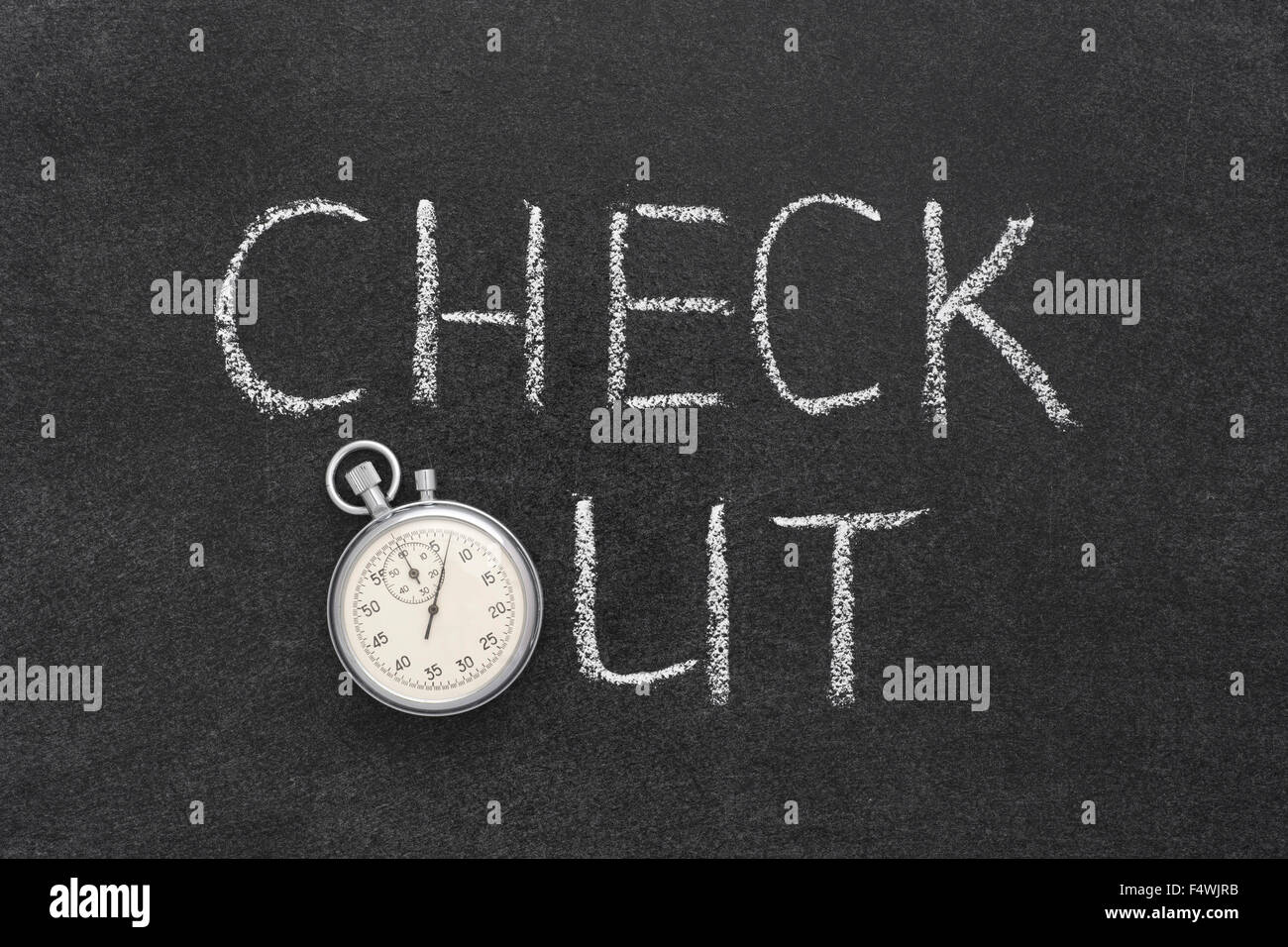 check out phrase handwritten on chalkboard with vintage precise stopwatch used instead of O - Stock Image