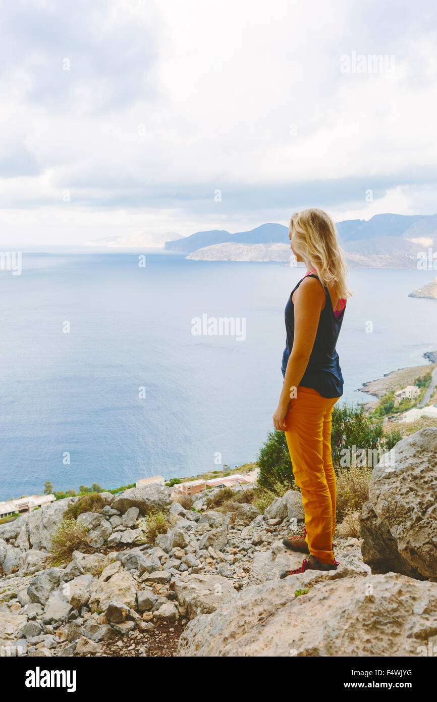 Greece, Dodecanese, Kalymnos, Tourist looking at sea - Stock Image