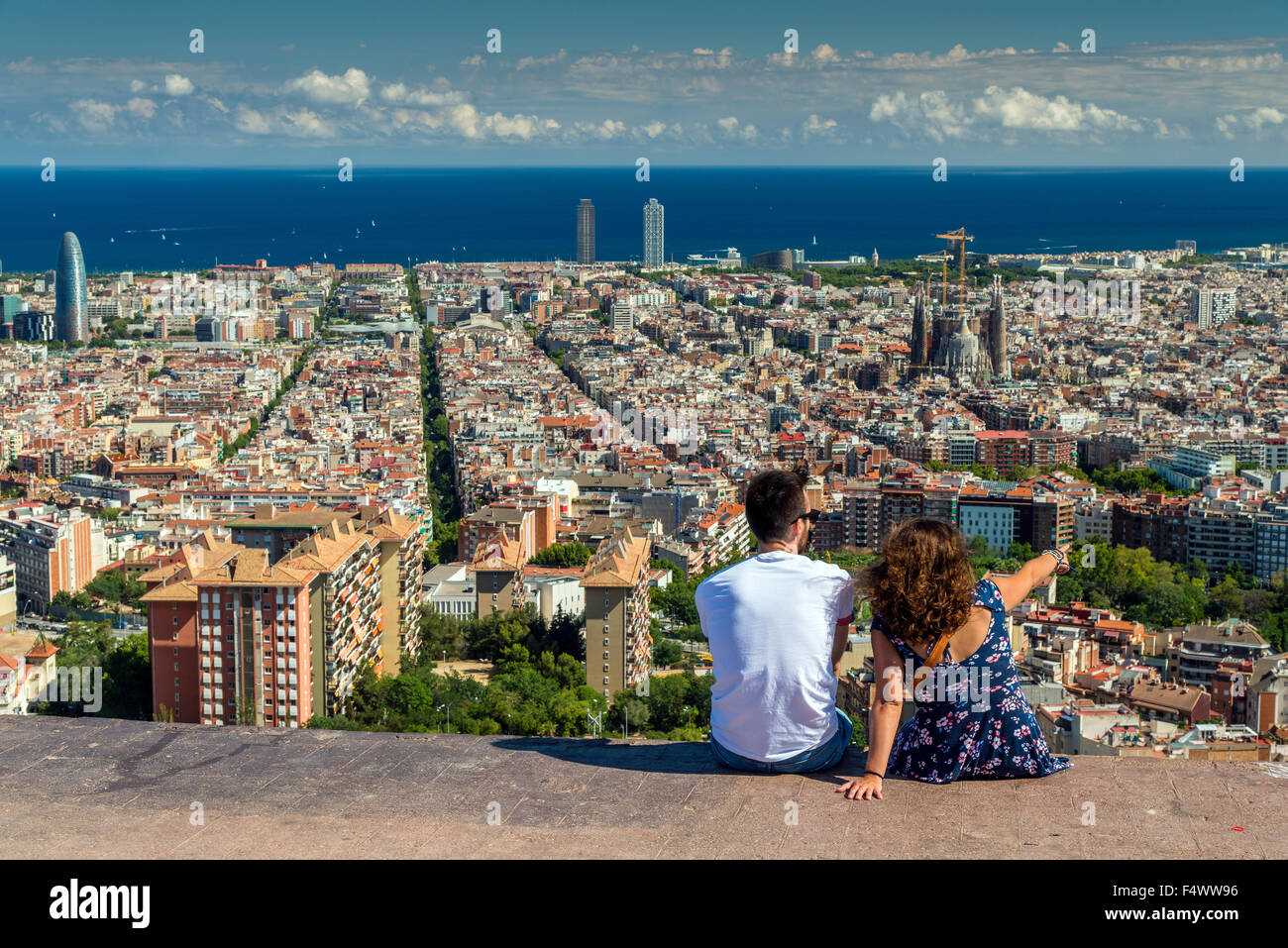 Tourists watching the city skyline, Barcelona, Catalonia, Spain - Stock Image