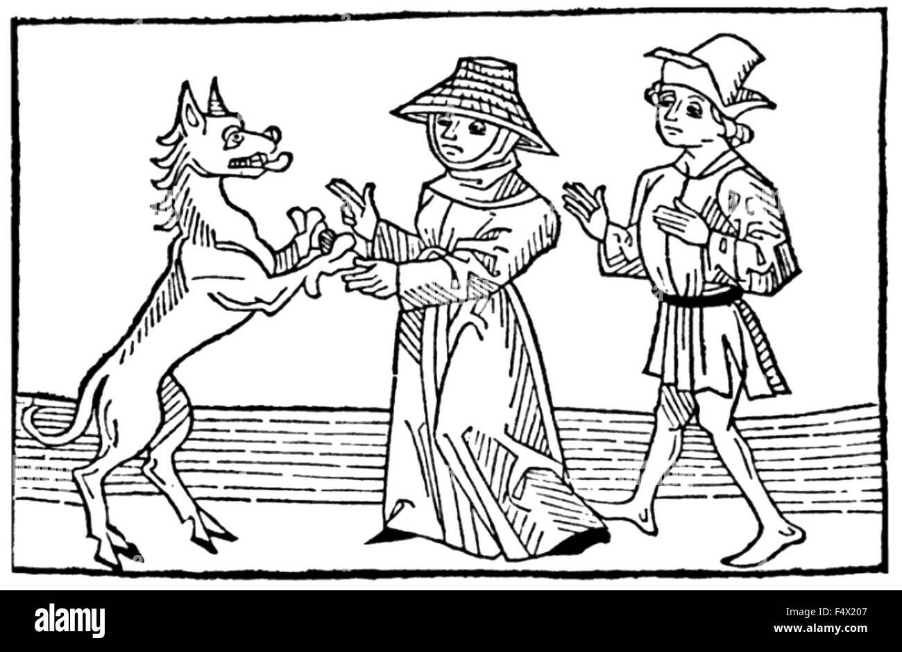 WITCHCRAFT Medieval woodcut of a male and femail witches with the Devil in the form of a huge dog. Note the cloven - Stock Image