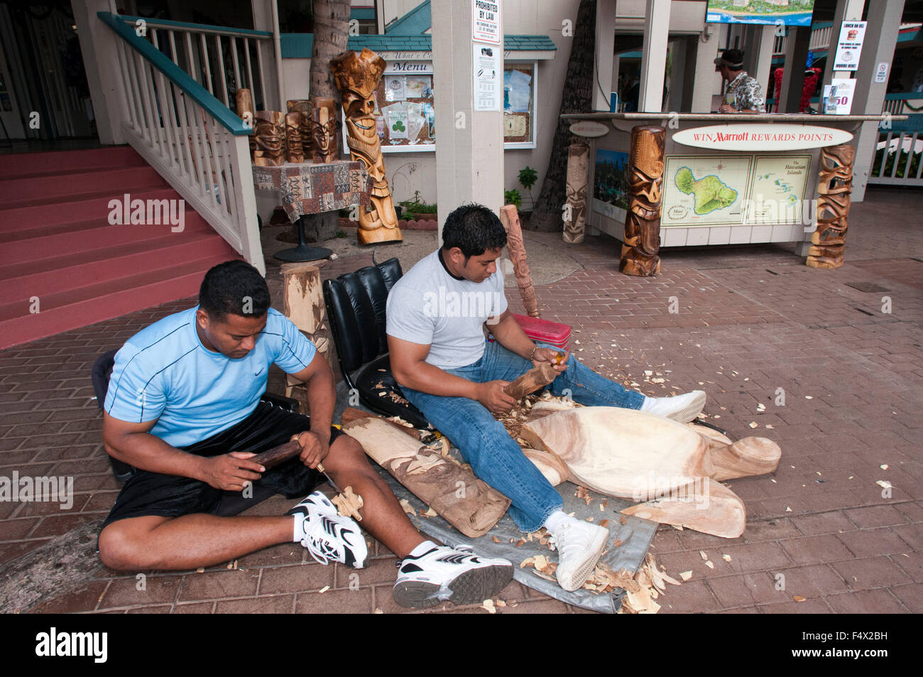 master woodworker and carver, in the Lahaina Cannery Shopping Center, works on crafts - Stock Image