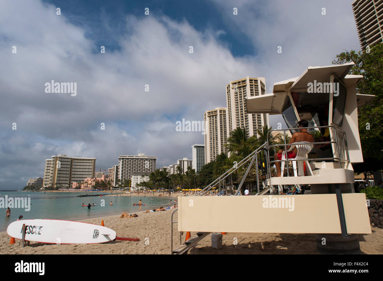 Life guard at Beach of Waikiki Beach. O'ahu. Hawaii. Waikiki is most famous for its beaches and every room is - Stock Image