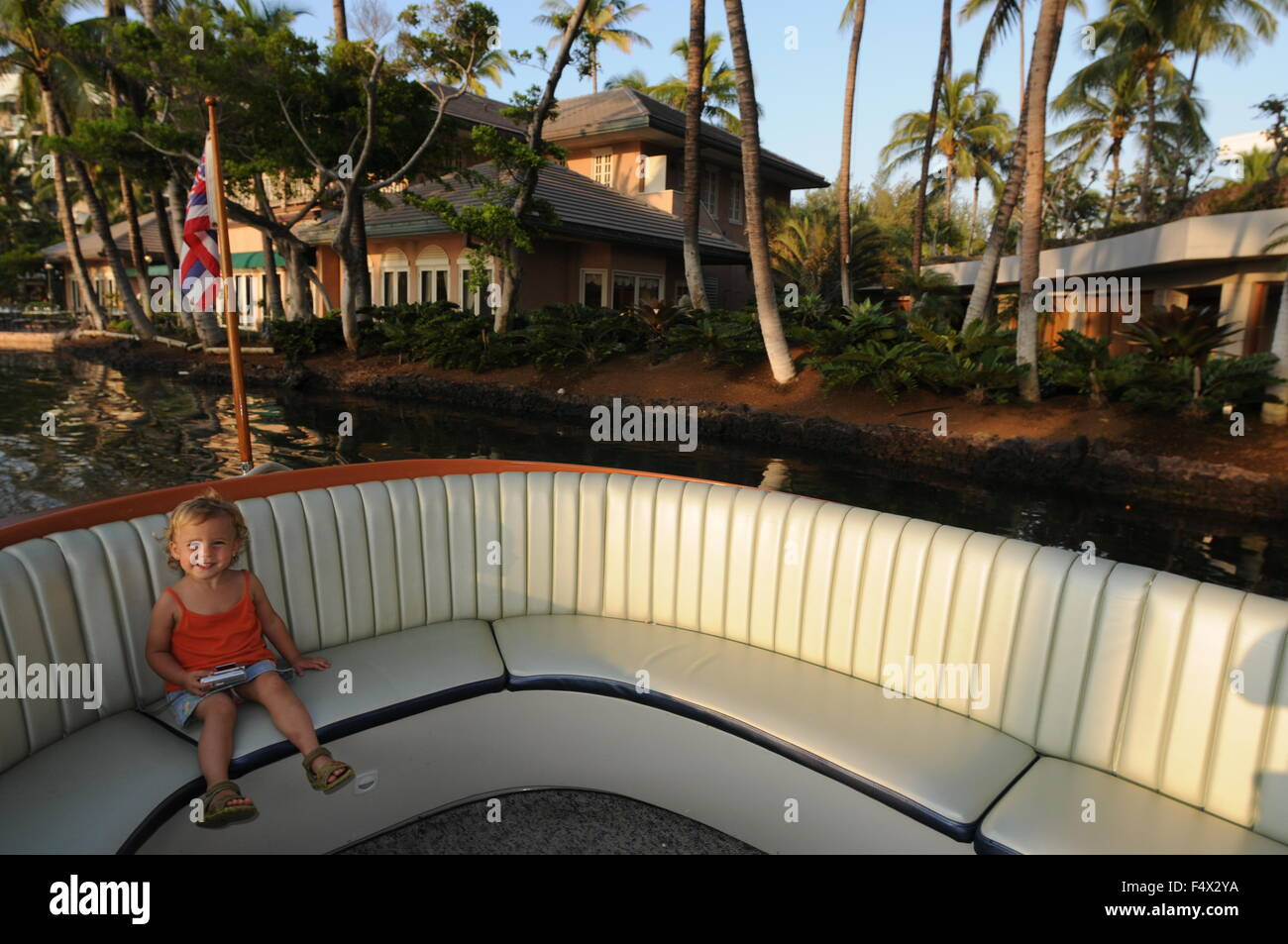 Girl inside a boat in the lagoon at Hilton Waikoloa Village
