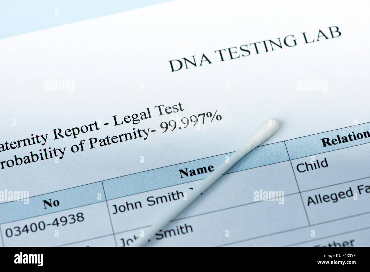 Paternity test results with lab sample swab. - Stock Image
