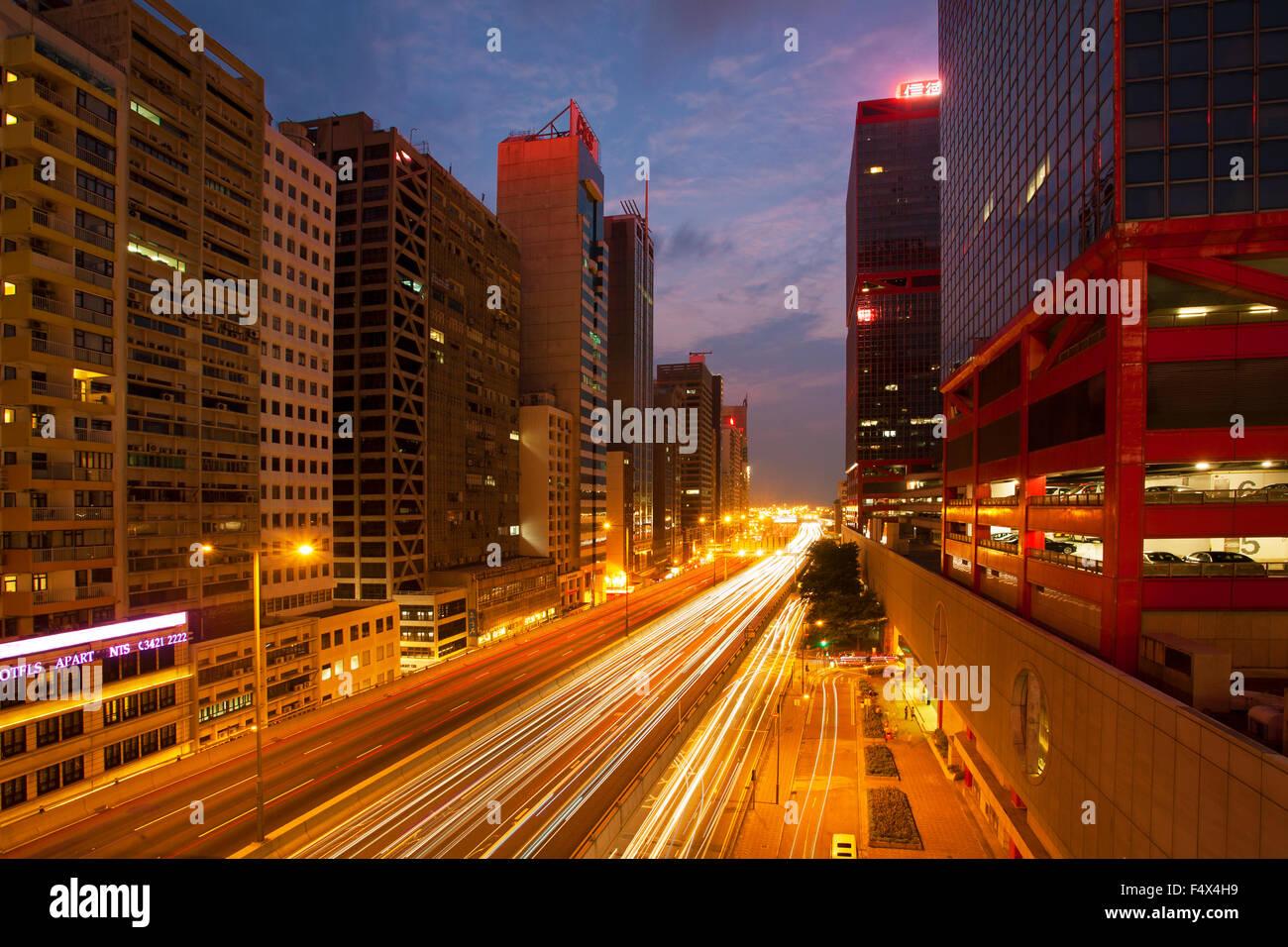 Traffic light trails through Hong Kong Island at twilight, Hong Kong China - Stock Image