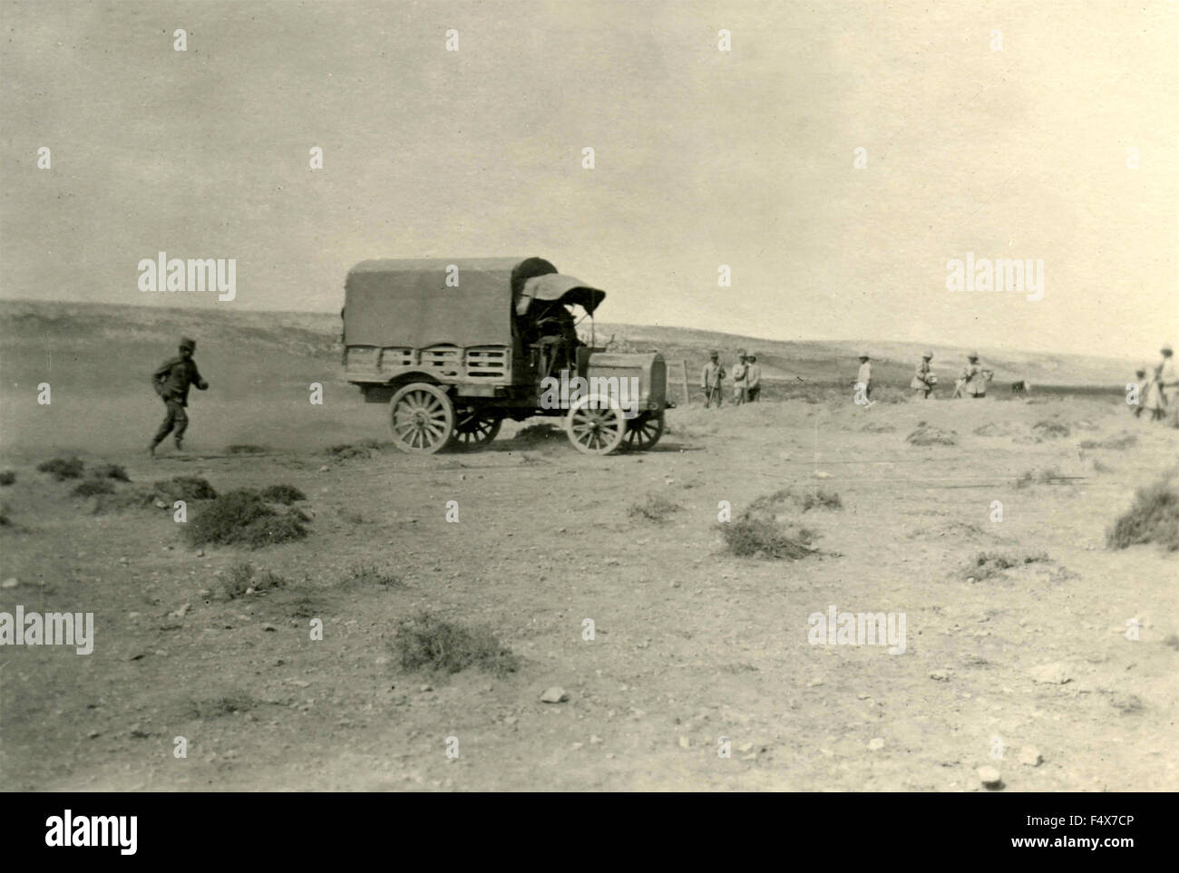 An army truck near the troops digging trenches - Stock Image