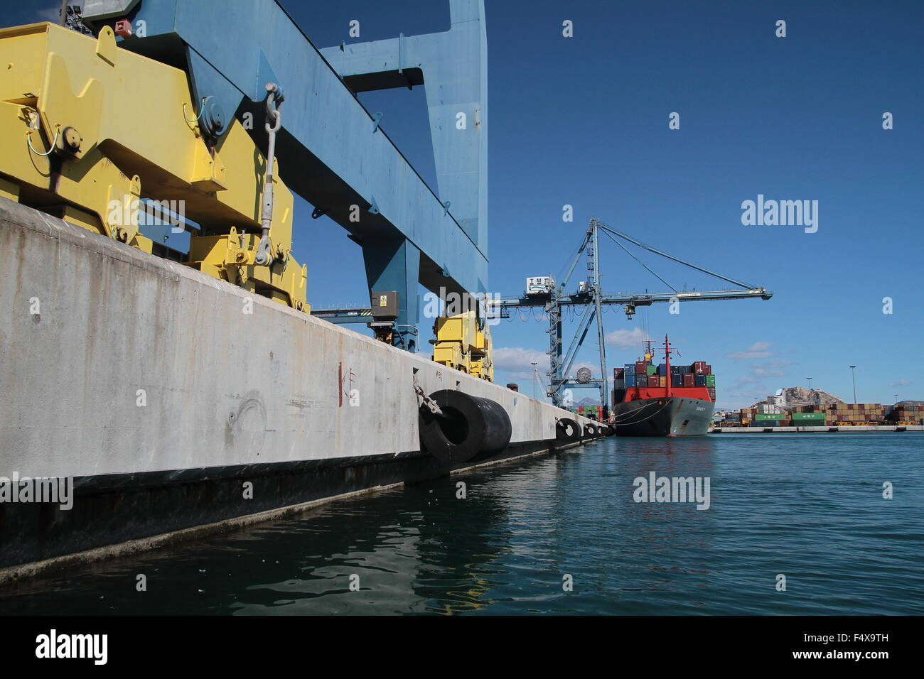 Container ship loading containers in Alicante - Stock Image