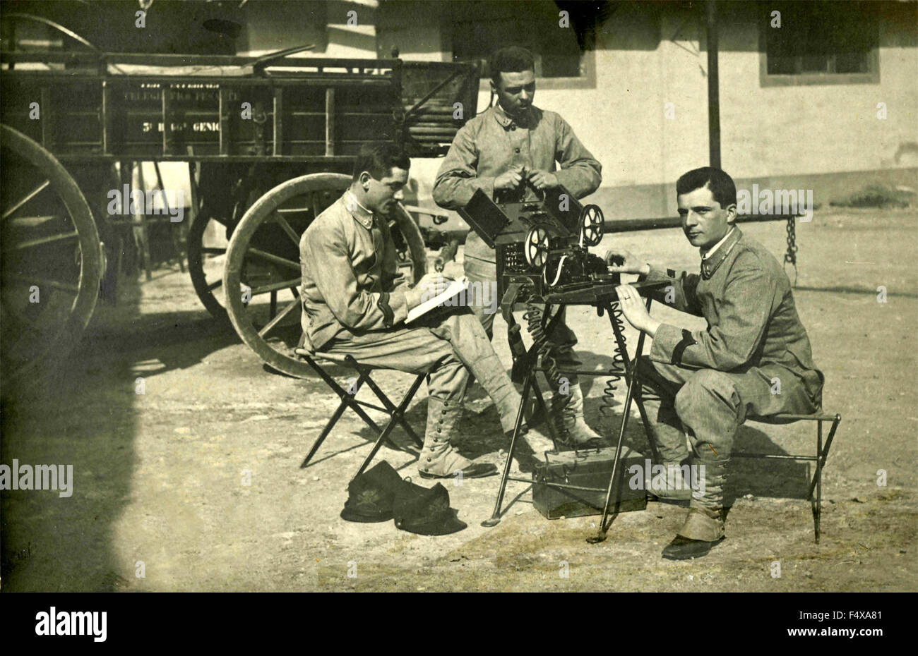 Three soldiers broadcast messages with Morse code, Italy - Stock Image