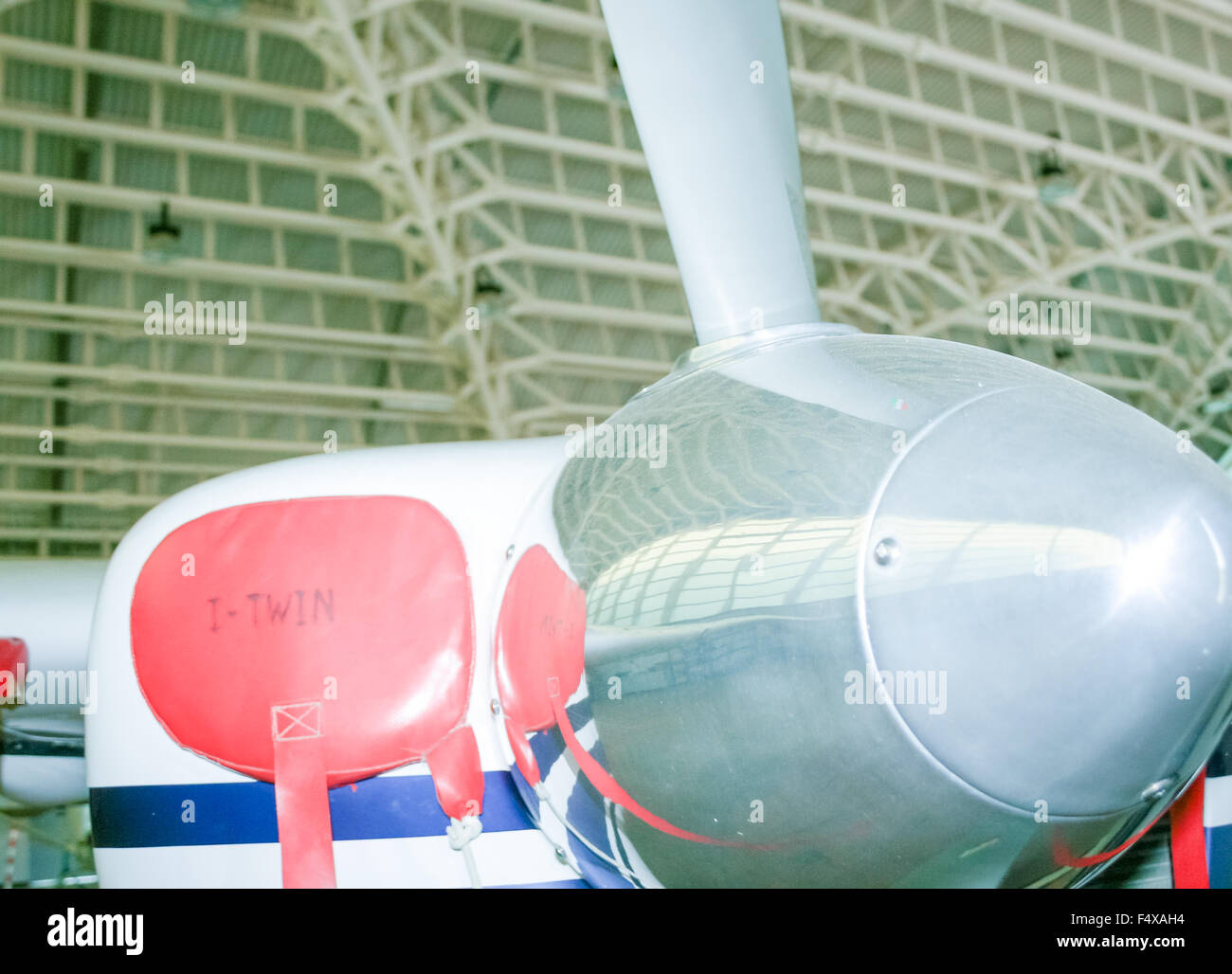 PROPELLER AIRPLANE REFLECTION. In front of a helix of a little airplane - Stock Image