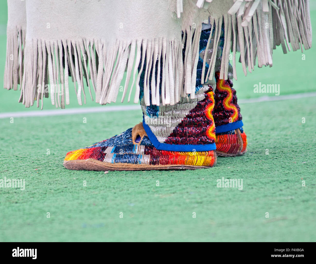 Hand-beaded moccasins highlight a dancer's costume at the Indian PowWow on the Blackfeet Reservation, Browning, - Stock Image