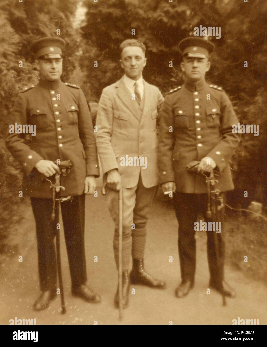 Portrait of two German soldiers and a civilian - Stock Image