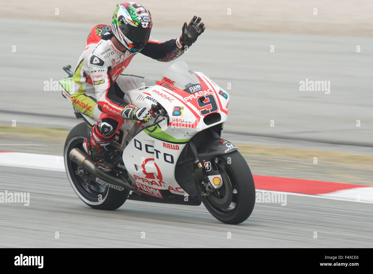 Sepang Circuit, Malaysia. 23rd Oct, 2015. Danilo Petrucci waving during the Free Practice sessions for the Shell - Stock Image