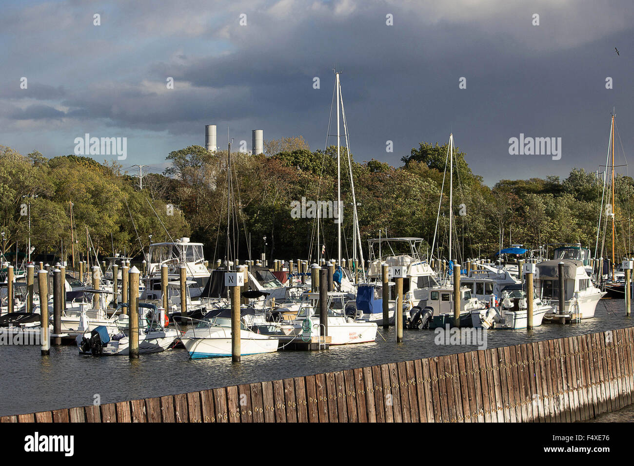 Waterfront scenic- Sailboats and motorboats await the next summer season docked at Roslyn Harbor NY - Stock Image