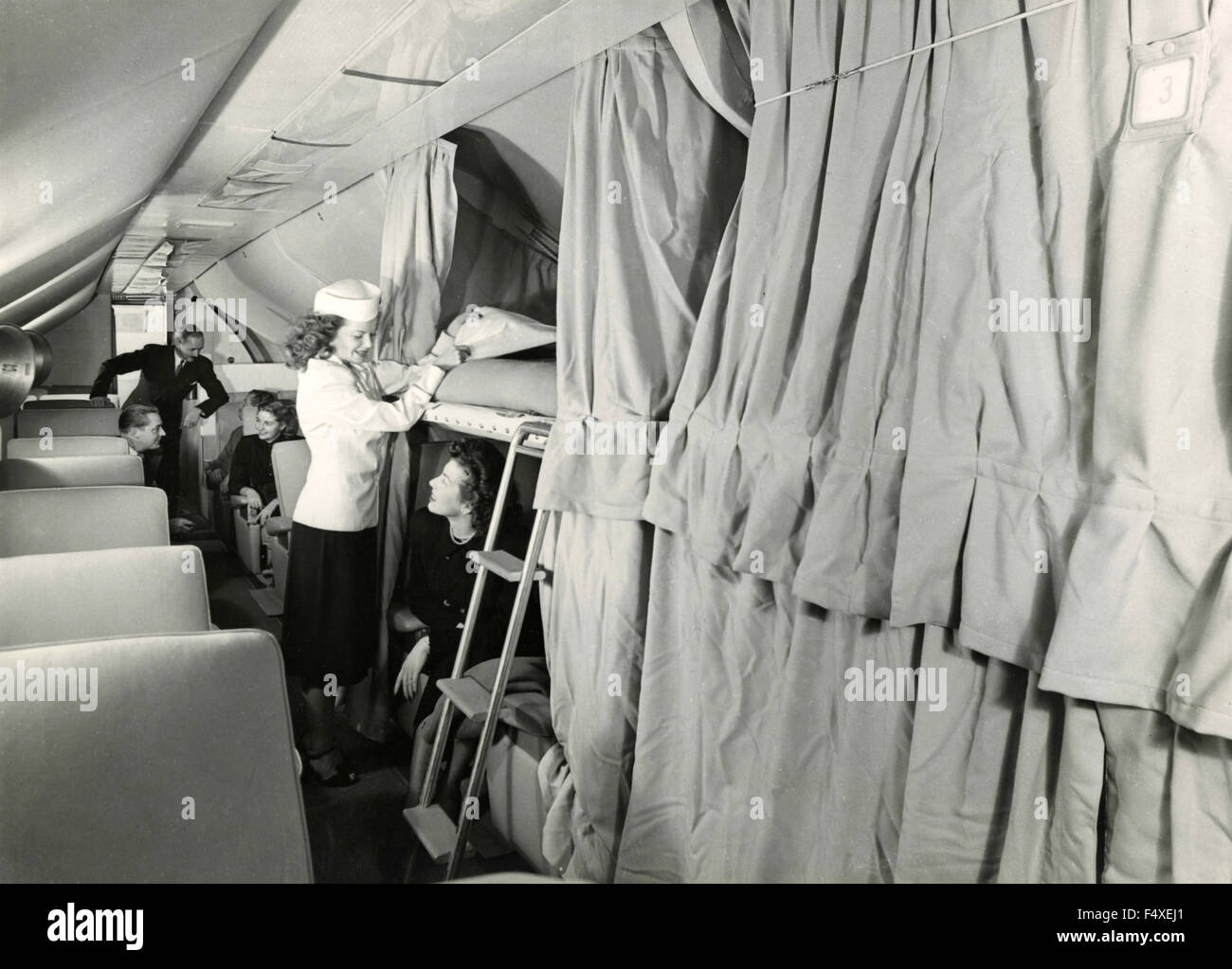 The interior of a plane with bunk beds - Stock Image