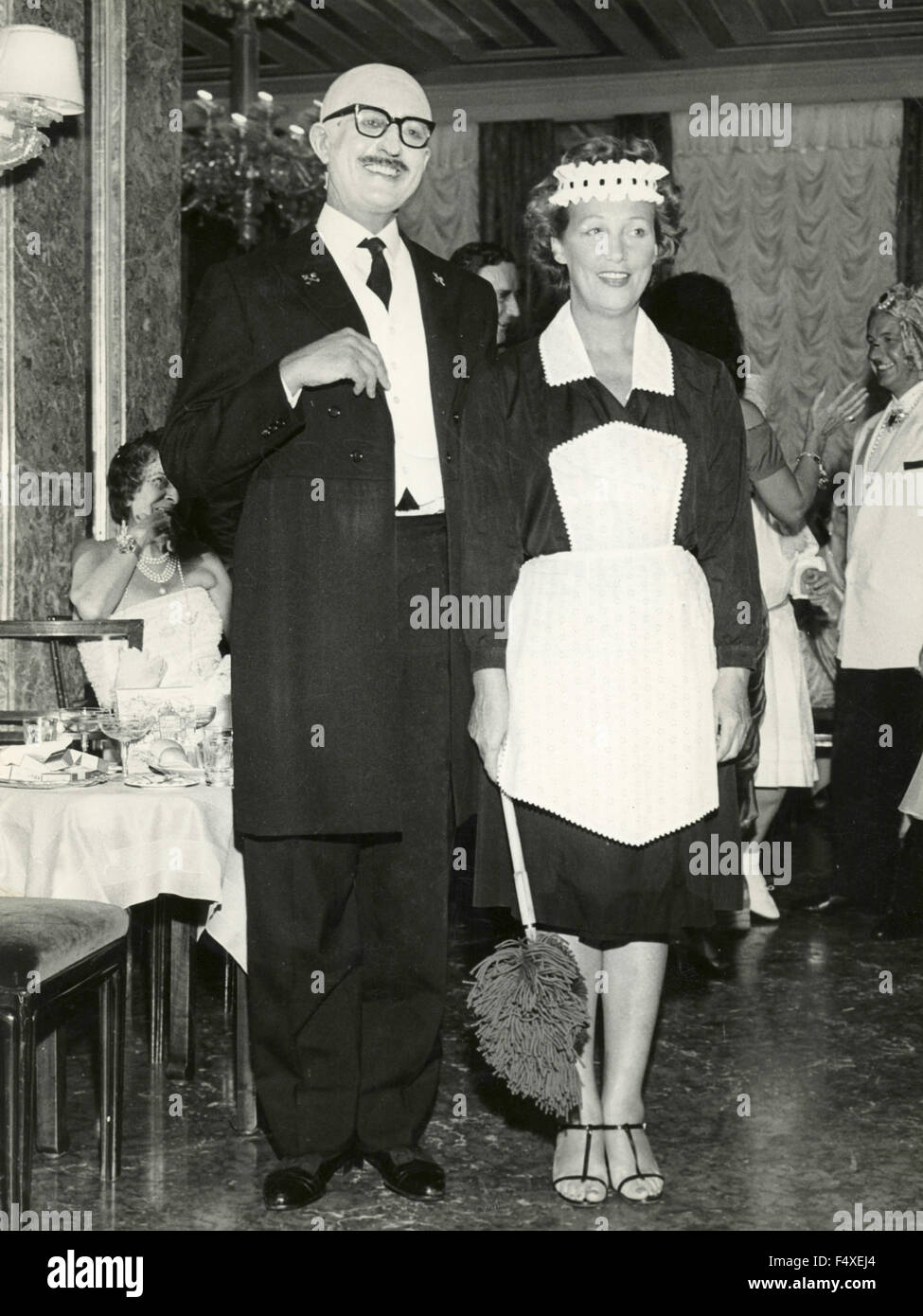 Count Guido Brandolini and Mrs. Drue Heinz to dance at Elsa Maxwell's party at the Danieli, Venice, Italy - Stock Image