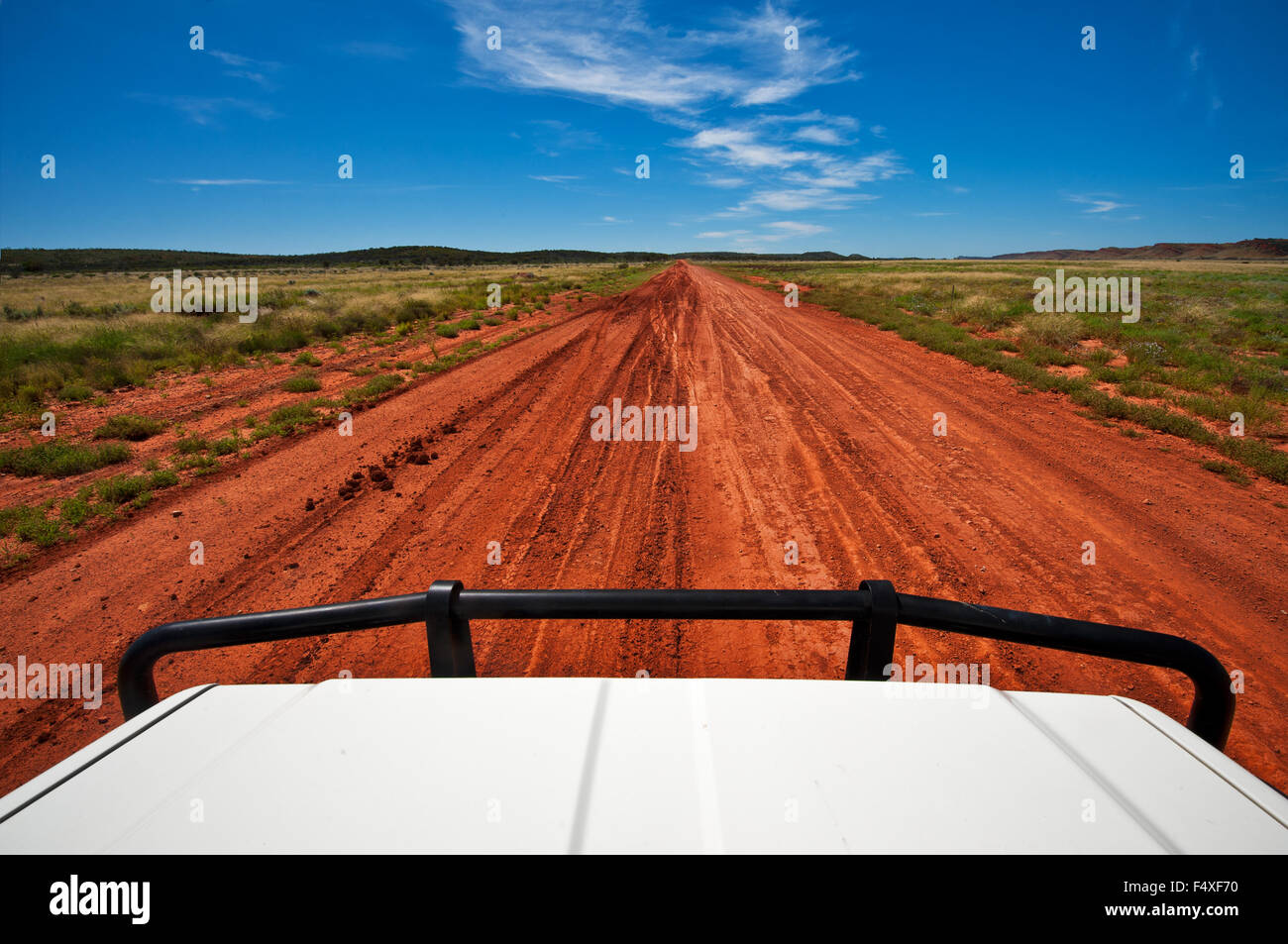 Red desert track in Central Australia. - Stock Image