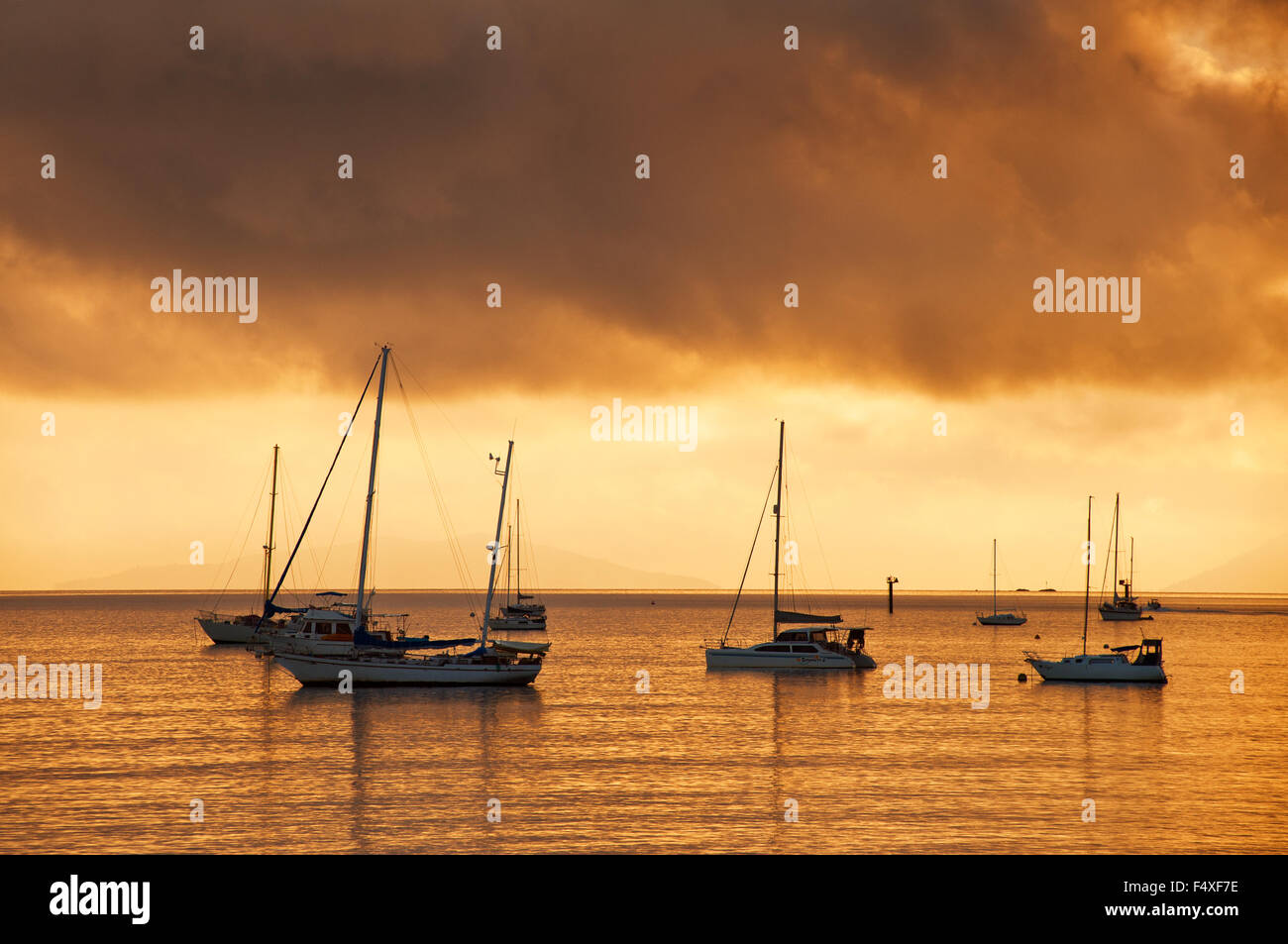 Sail boats at sunrise in Airlie Beach. - Stock Image