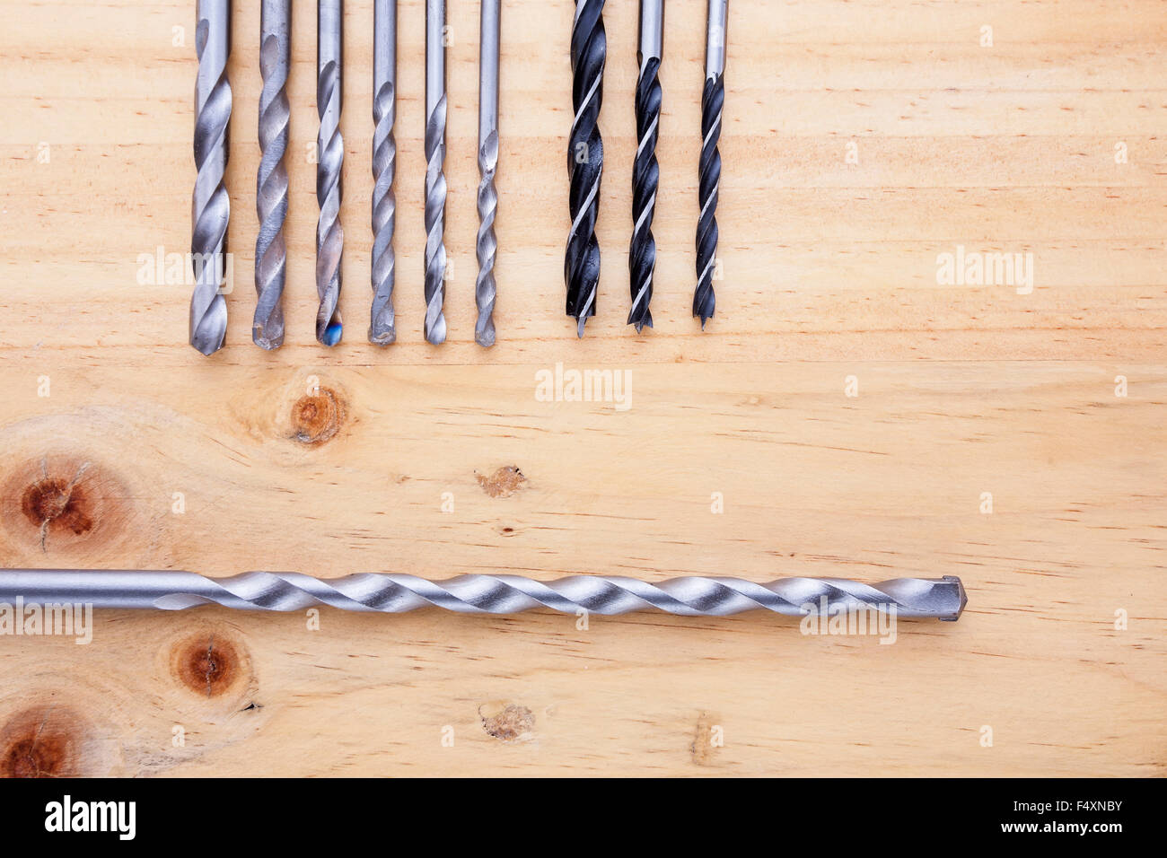 Difference kind of countersinks on wooden table - Stock Image
