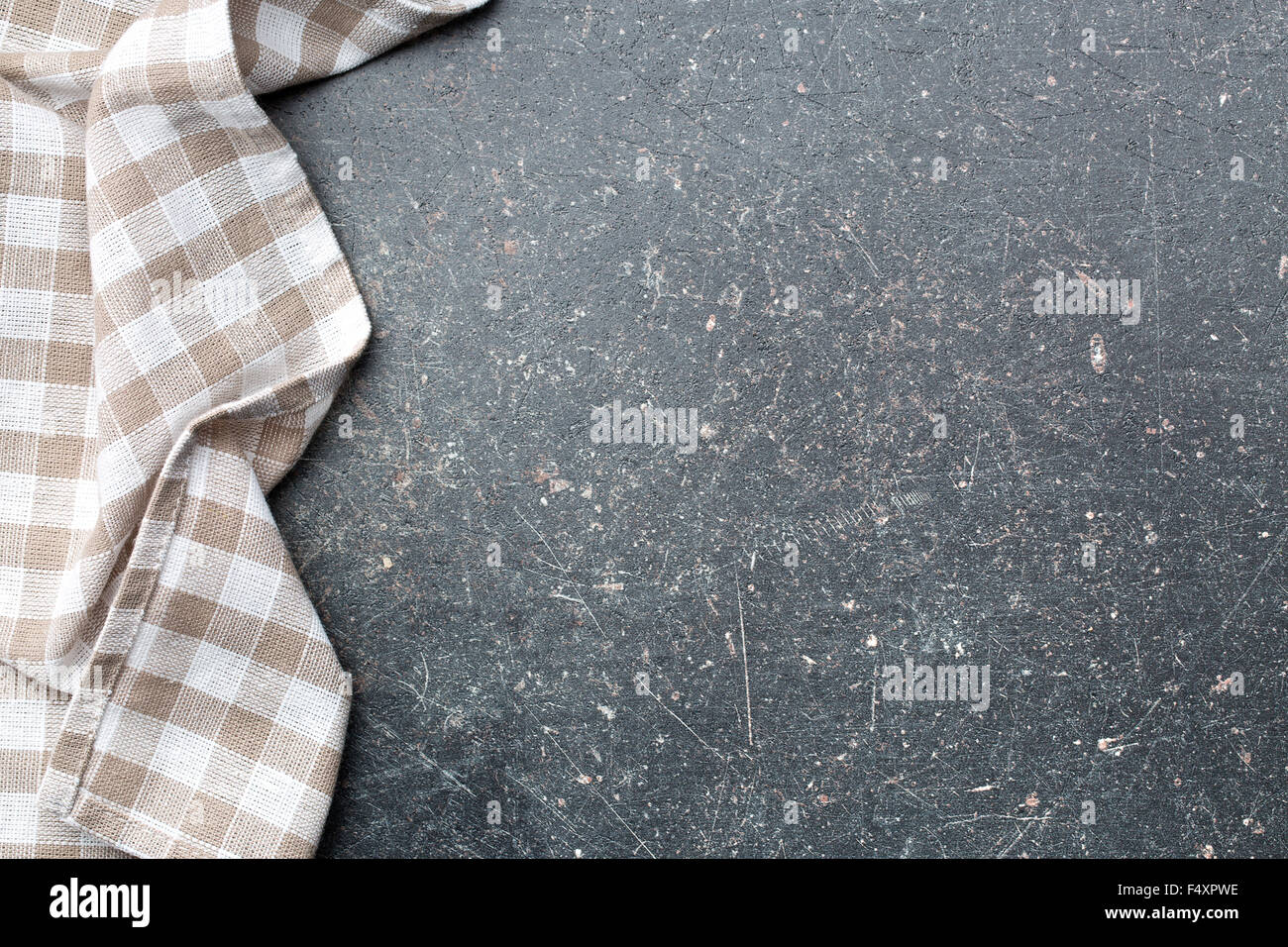 checkered tablecloth over old kitchen table - Stock Image