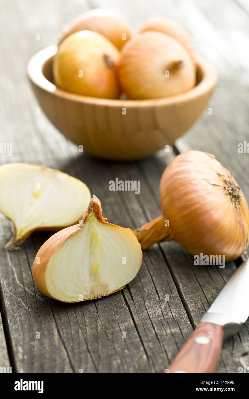 halved fresh onion on wooden old table Stock Photo