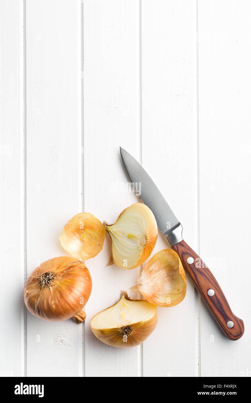 halved fresh onion on a kitchen table Stock Photo