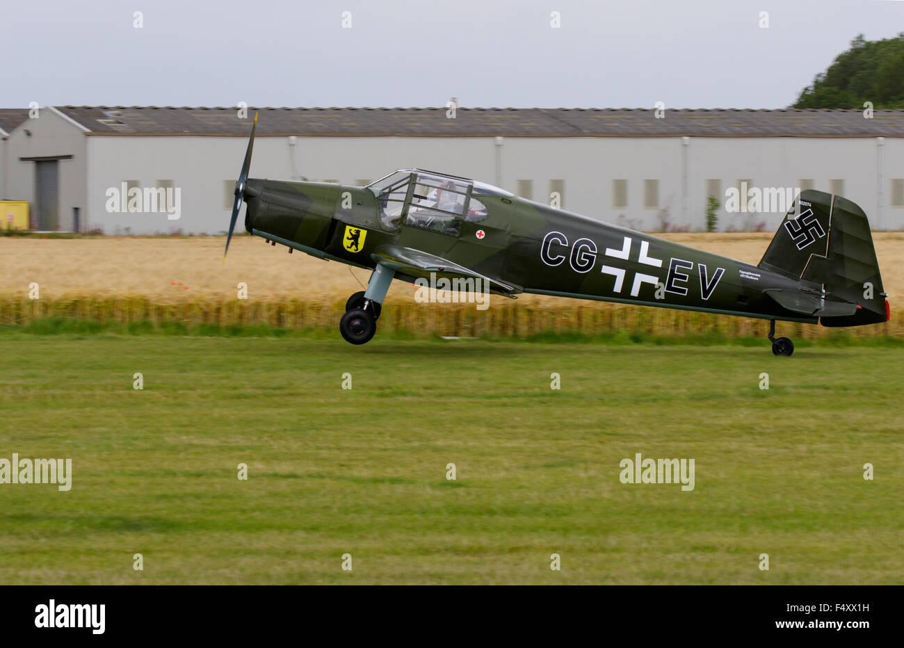 Gomhouria 181 MK6 (Bucker Bestman) CG-EV G-CGEV landing at Breighton Airfield - Stock Image