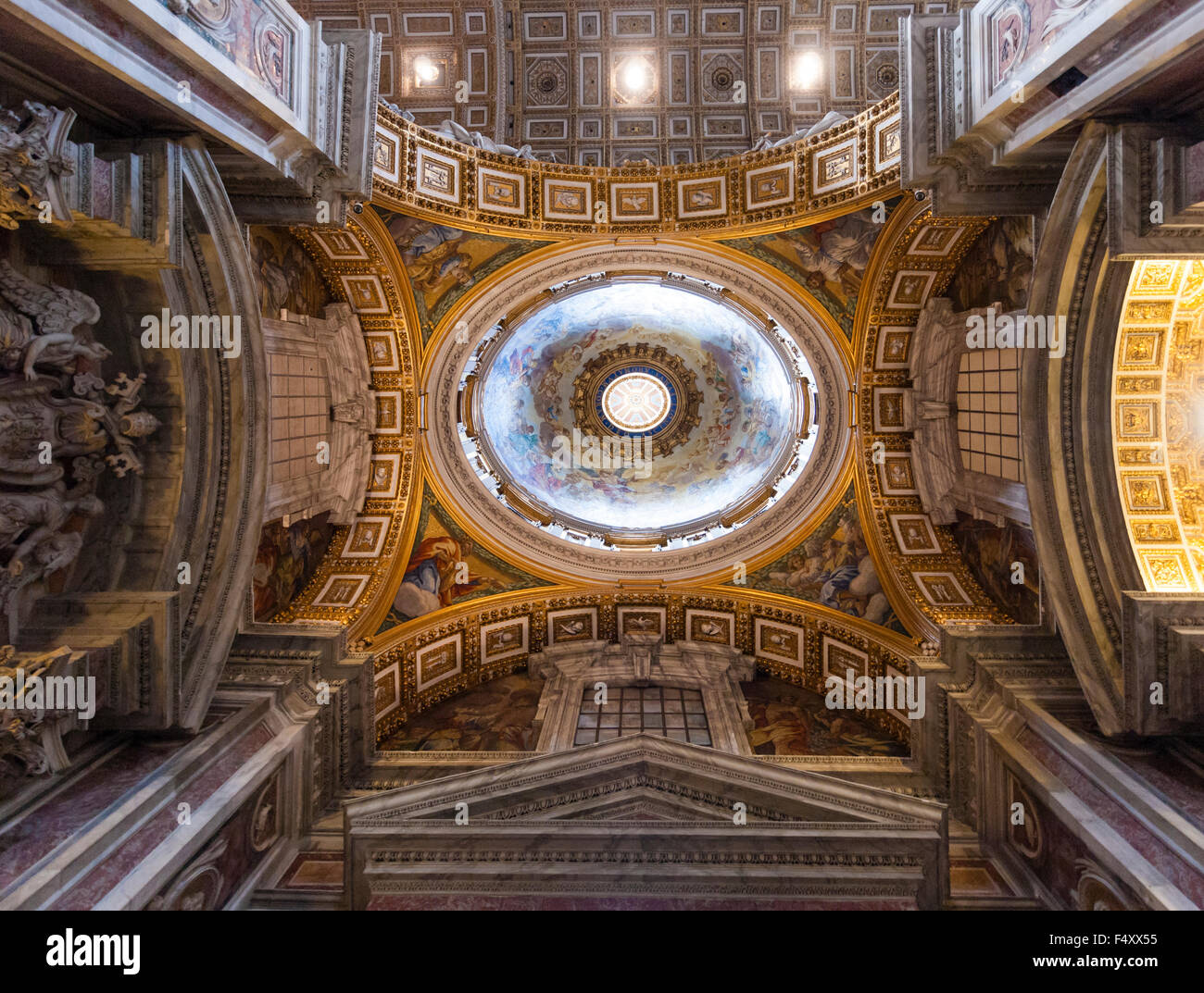 Interior of St. Peter's Basilica, Vatican: main dome above the chancel, seen from below - Stock Image