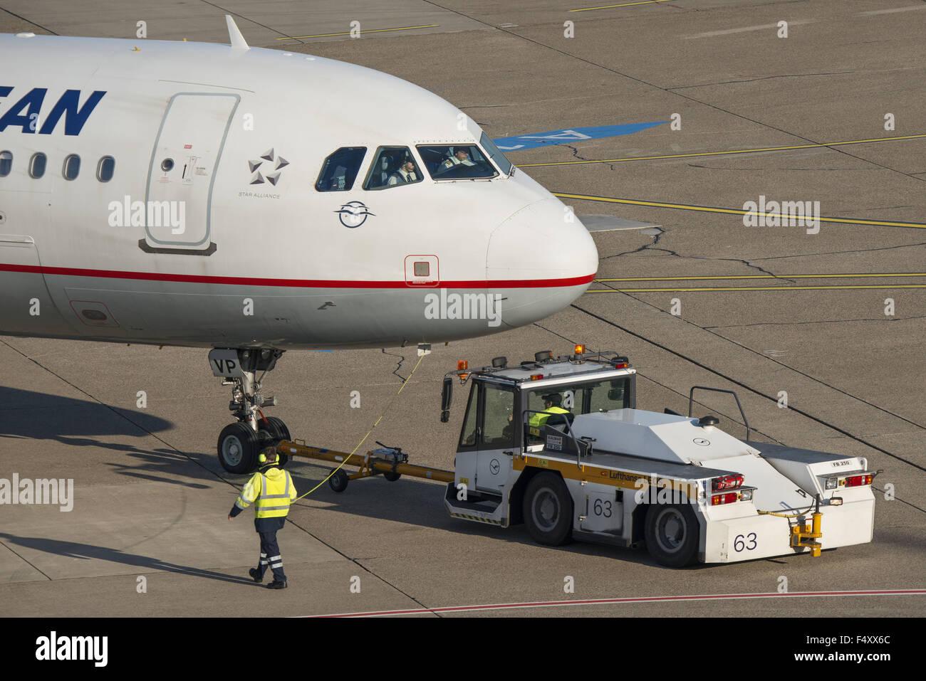 Aircraft during push-back, Düsseldorf airport, DUS, North Rhine-Westphalia, Germany - Stock Image