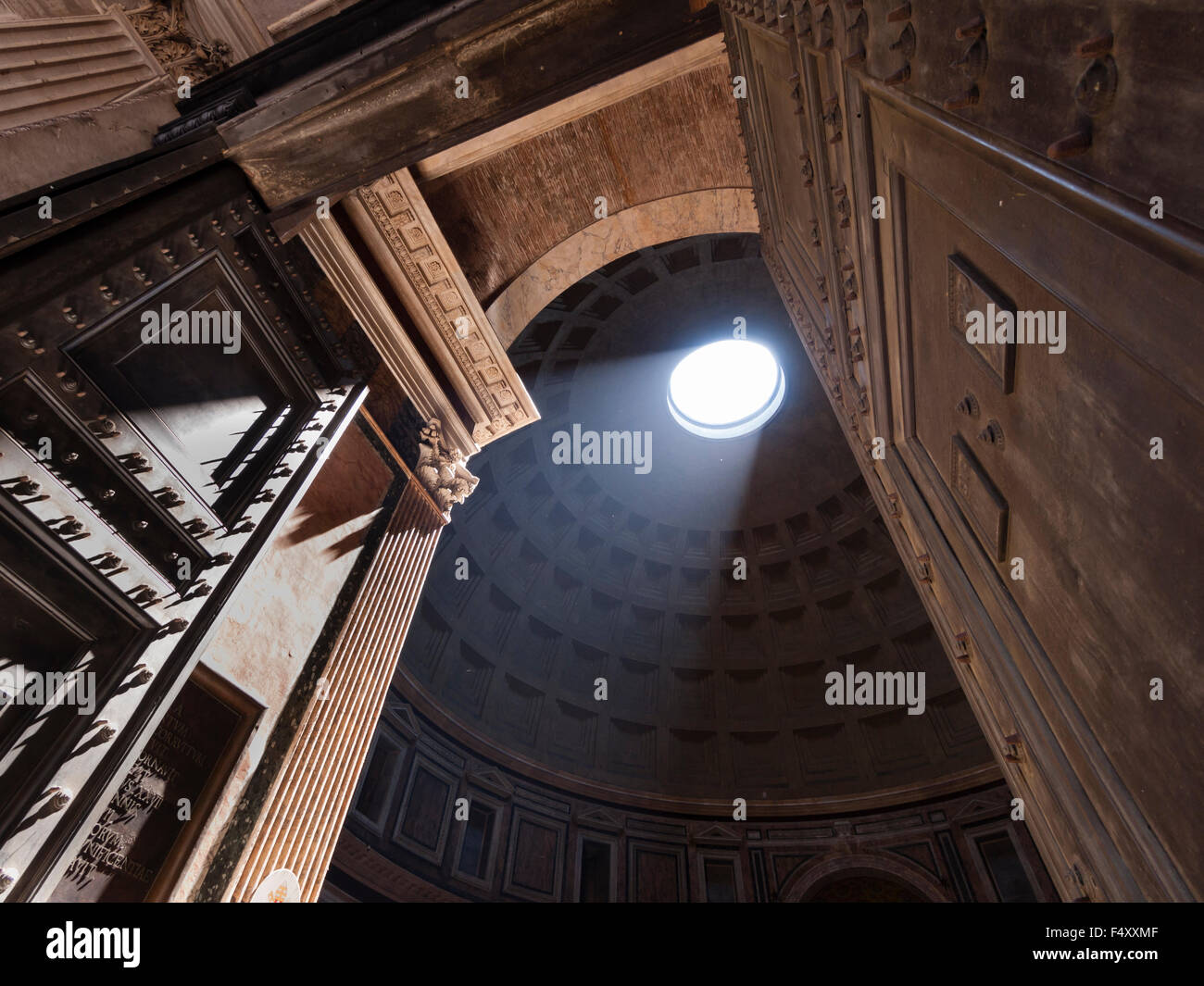 Sunlight is shining into the ancient Roman Pantheon temple through the characteristic hole in the middle of its Stock Photo