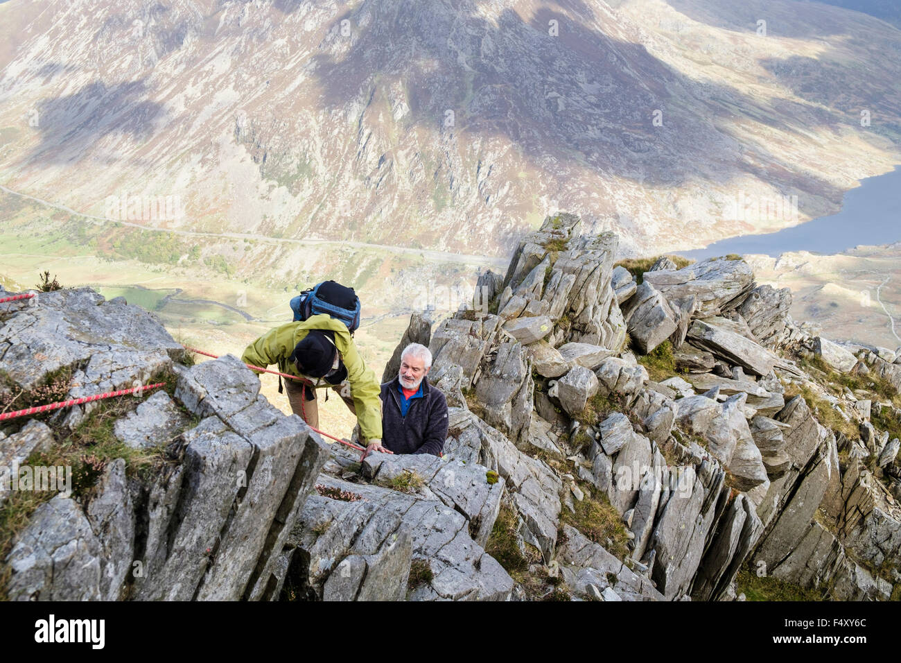 Senior Hikers Climbing Using A Safety Rope On Y Garn Mountain North East Ridge High Above