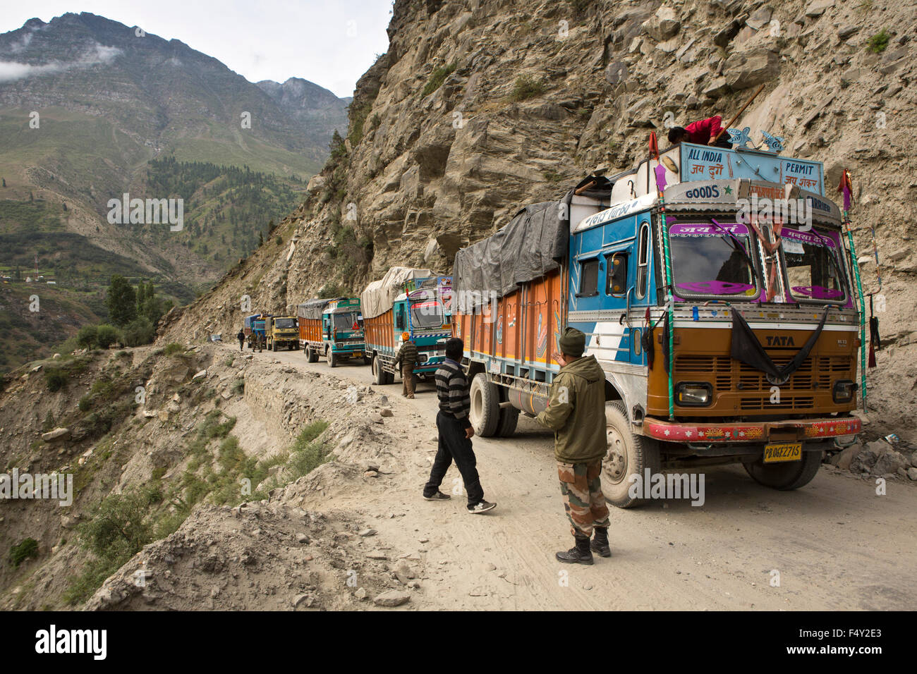 India, Himachal Pradesh, Lahaul and Spiti, Keylong, queue of trucks blocking narrow mountain road - Stock Image
