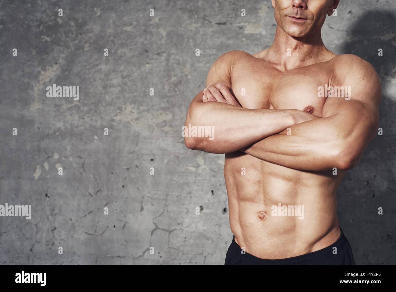 Fitness portrait half body six pack no shirt, fitness concept, room for copyspace, fit and healthy male body with - Stock Image